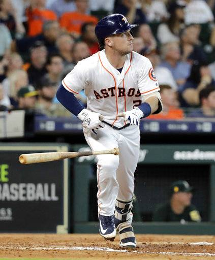 Houston Astros' Alex Bregman drops his bat after hitting a two-run double during the third inning of a baseball game against the Oakland Athletics Thursday, July 12, 2018, in Houston.