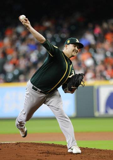 Oakland Athletics starting pitcher Trevor Cahill throws against the Houston Astros during the first inning of a baseball game Thursday, July 12, 2018, in Houston.