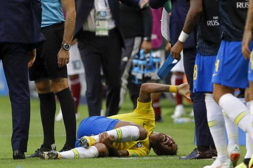 Brazil's Neymar lies on the ground during the round of 16 match between Brazil and Mexico at the 2018 soccer World Cup in the Samara Arena, in Samara, Russia, Monday, July 2, 2018.