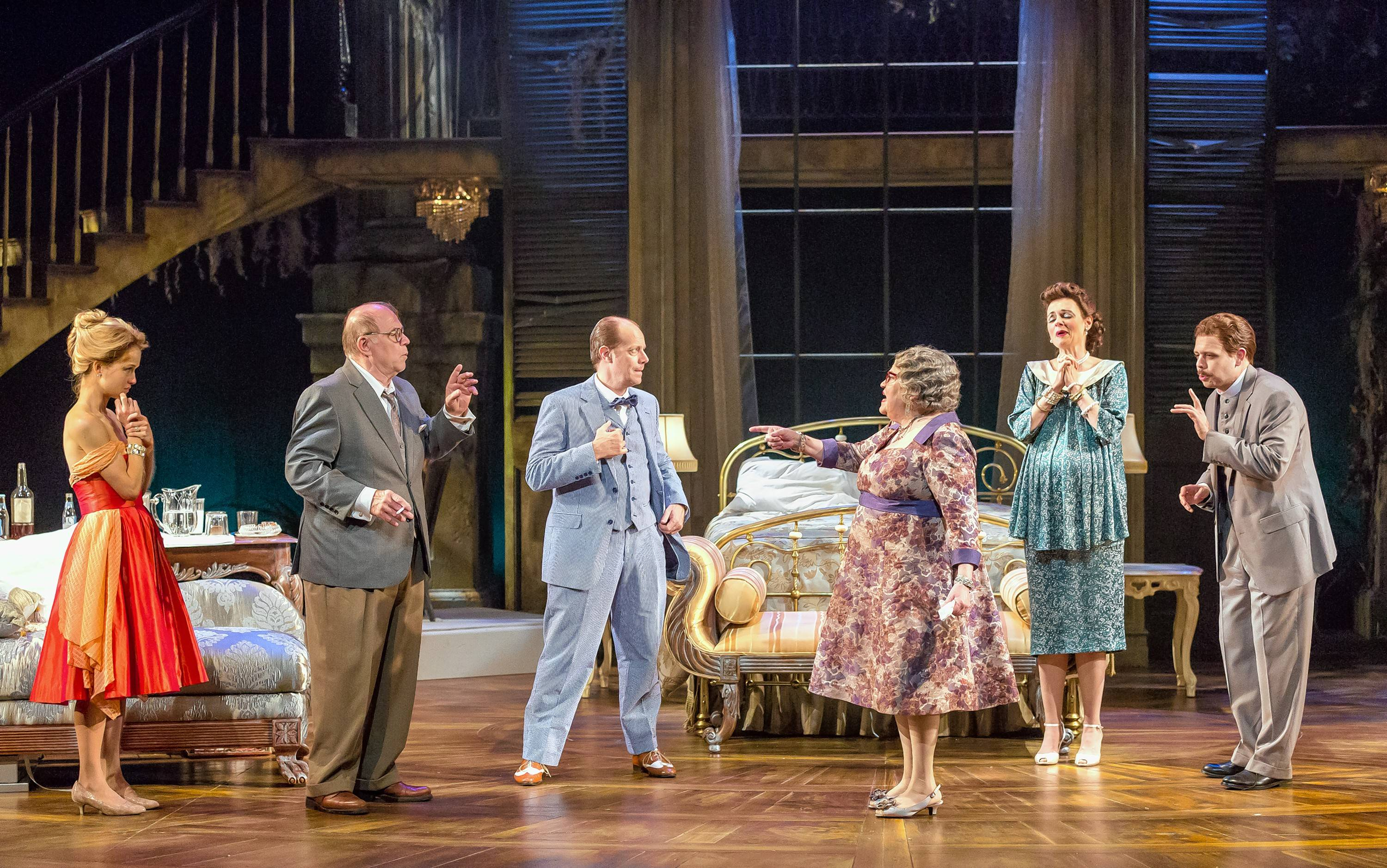 """Friends and family members attempt to break the news of her husband's fatal diagnosis to Big Mama (Cindy Gold, third from right) in director Marcia Milgrom Dodge's operatic revival of """"Cat on a Hot Tin Roof"""" at Drury Lane Theatre in Oakbrook Terrace."""