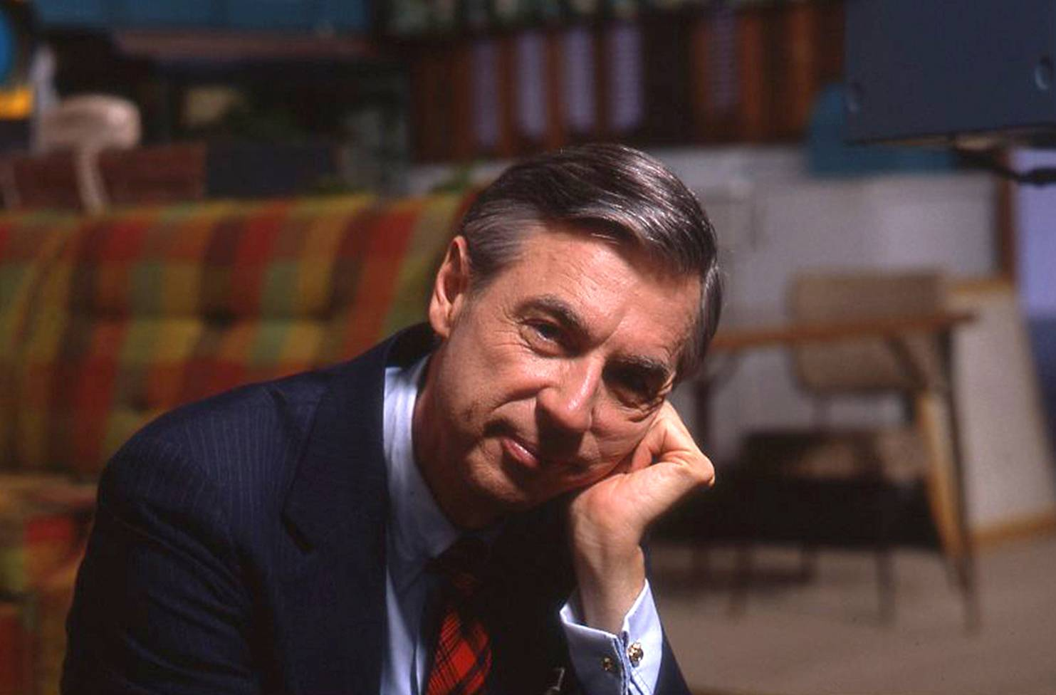 "Fred Rogers on the set of his show ""Mr. Rogers Neighborhood"" from the film ""Won't You Be My Neighbor."""