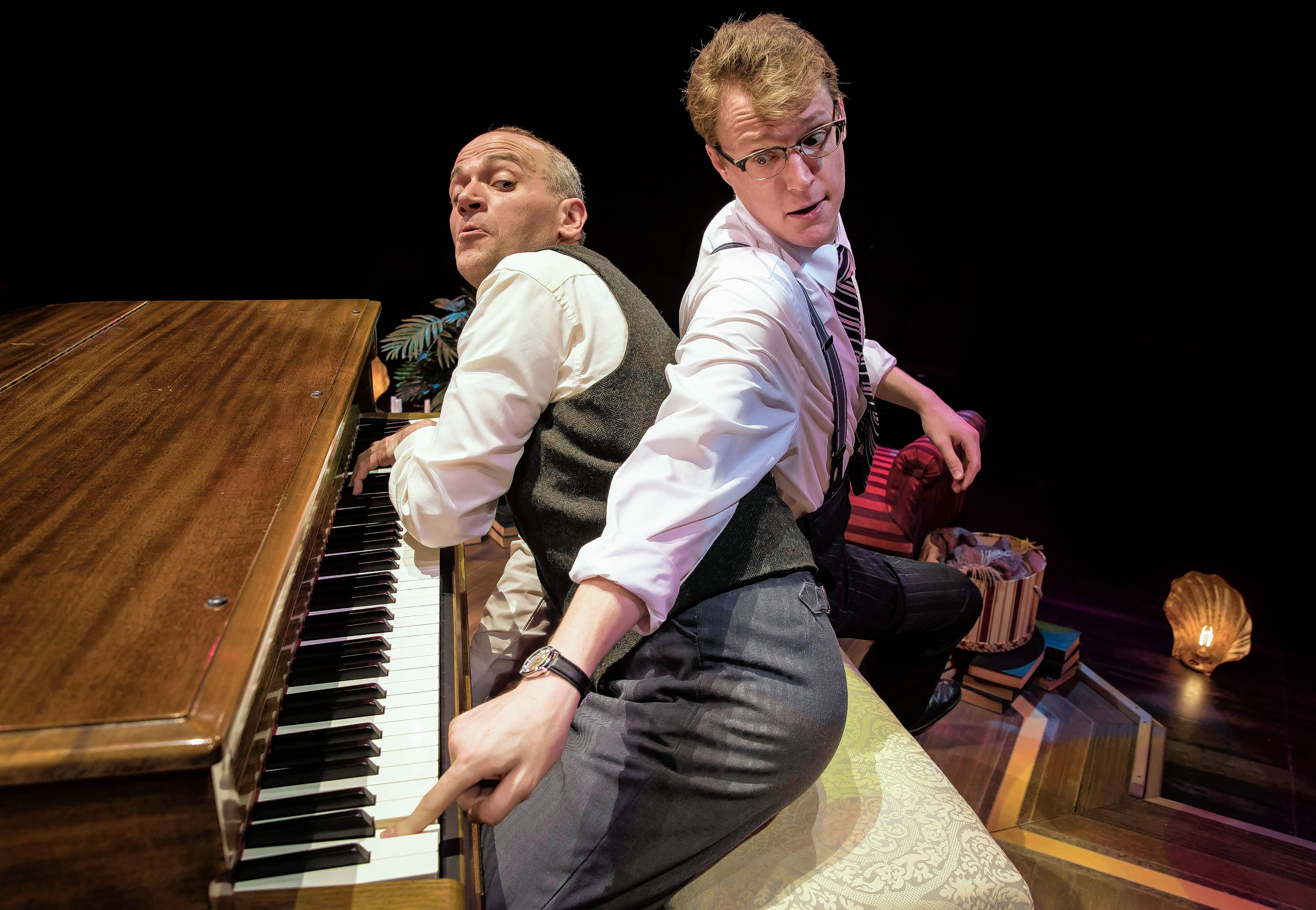 "Jason Grimm, left, plays all of the eccentric suspects and Noel Carey plays the aspiring police detective Marcus in the musical ""Murder for Two"" at the Marriott Theatre in Lincolnshire."