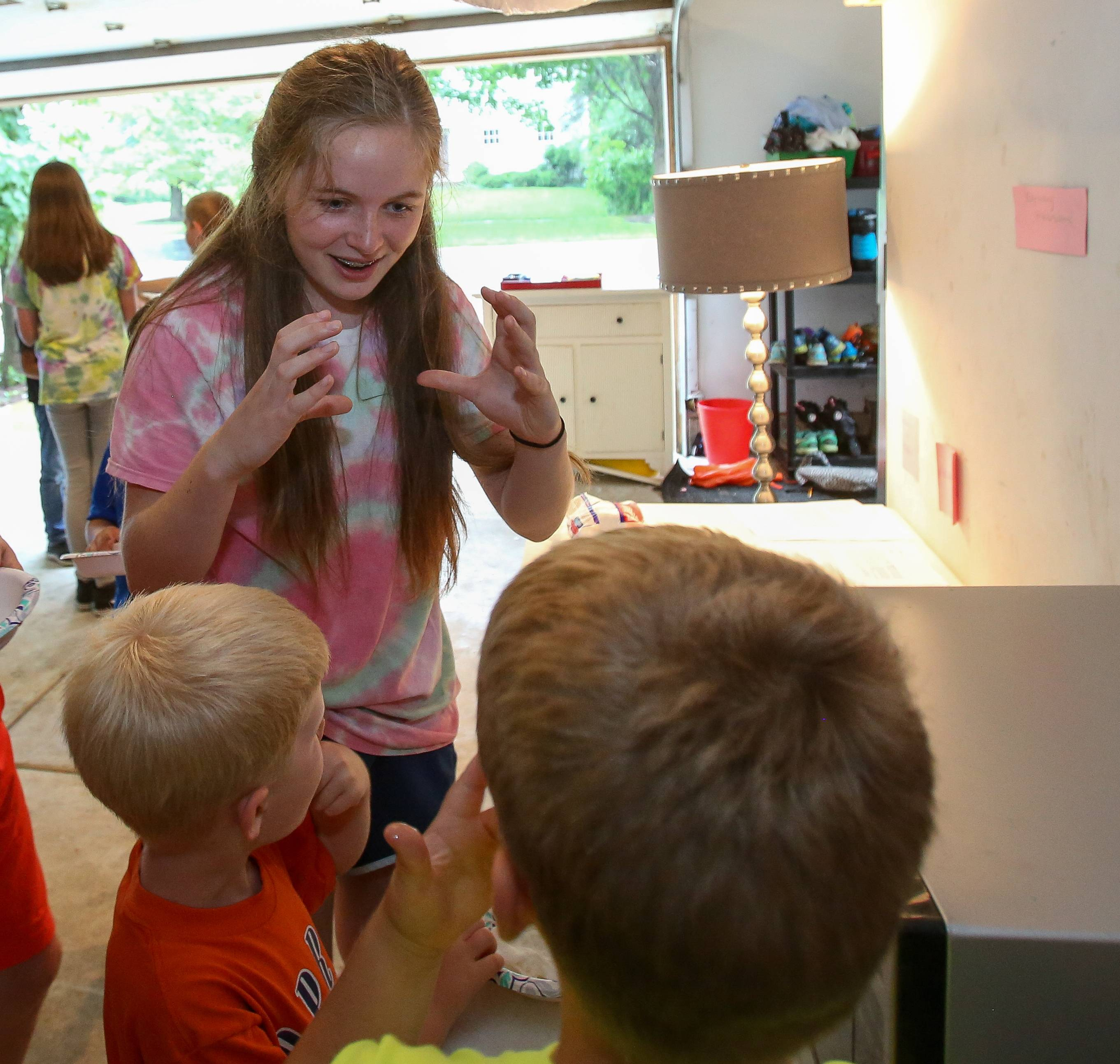 Addy Henninger, 13, works with kids in the science summer camp she started at age 11.
