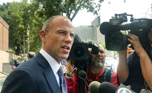 Porn actress Stormy Daniels' lawyer Michael Avenatti talks to the media outside of Los Angeles County Superior Court after a hearing in Los Angeles Tuesday, July 10, 2018. A judge has ordered a former Playboy centerfold model to provide copies of a lawsuit she filed last week to Avenatti and a top fundraiser for President Donald Trump. Los Angeles County Superior Court Judge Ernest Hiroshige handed down the ruling Monday, but denied requests to make the lawsuit public. Shera Bechard is suing Elliott Broidy, who disclosed last spring the two had an affair, and agreed to pay her $1.6 million as part of a confidentiality agreement. The suit also names Bechard's former attorney, Keith Davidson, and Avenatti.