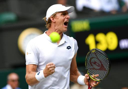Kevin Anderson of South Africa celebrates winning a point from John Isner of the US during their men's singles semifinal match at the Wimbledon Tennis Championships, in London, Friday July 13, 2018.