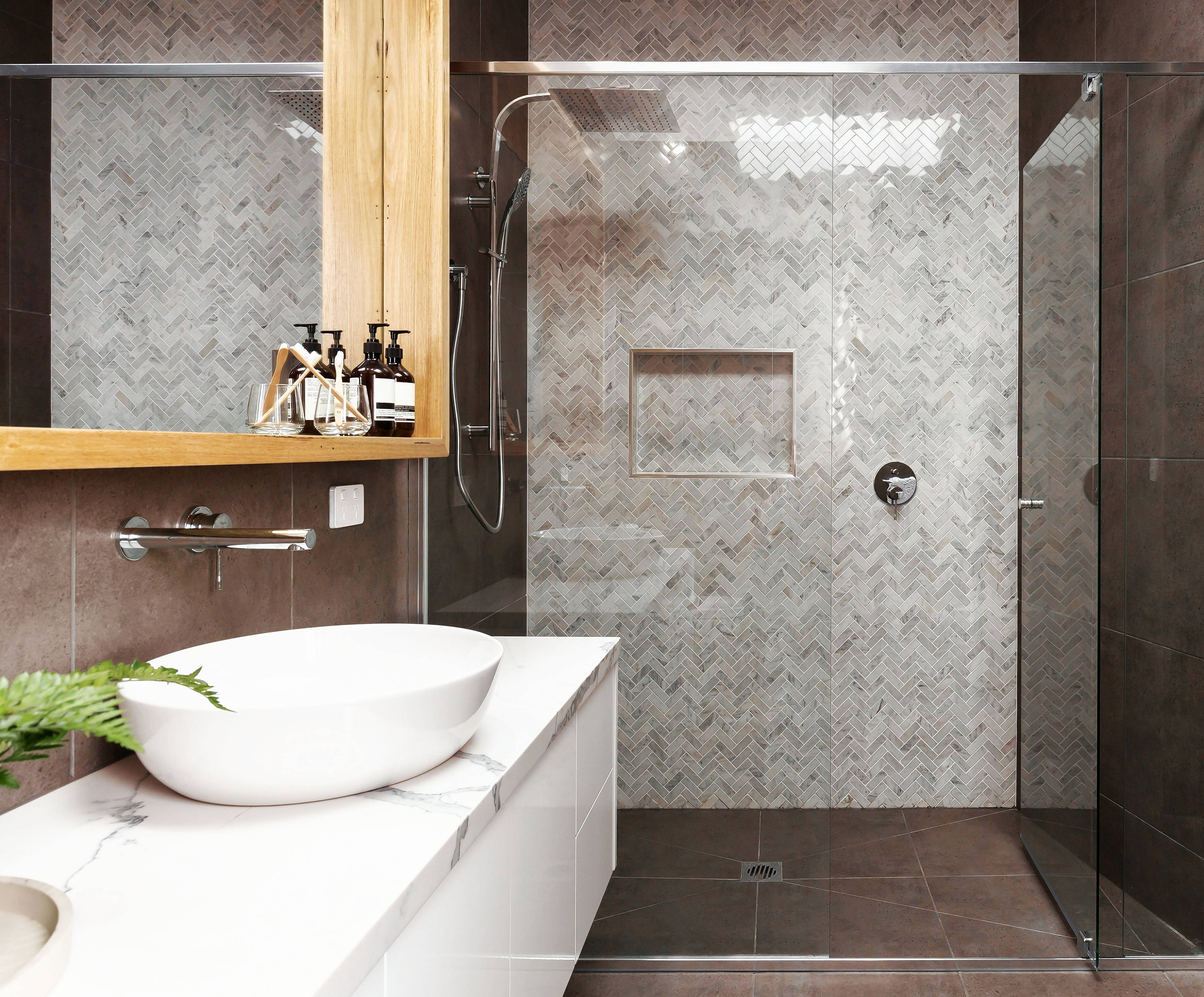 This shower, using marble tile in a mosaic herringbone pattern, makes for a contemporary bathroom.