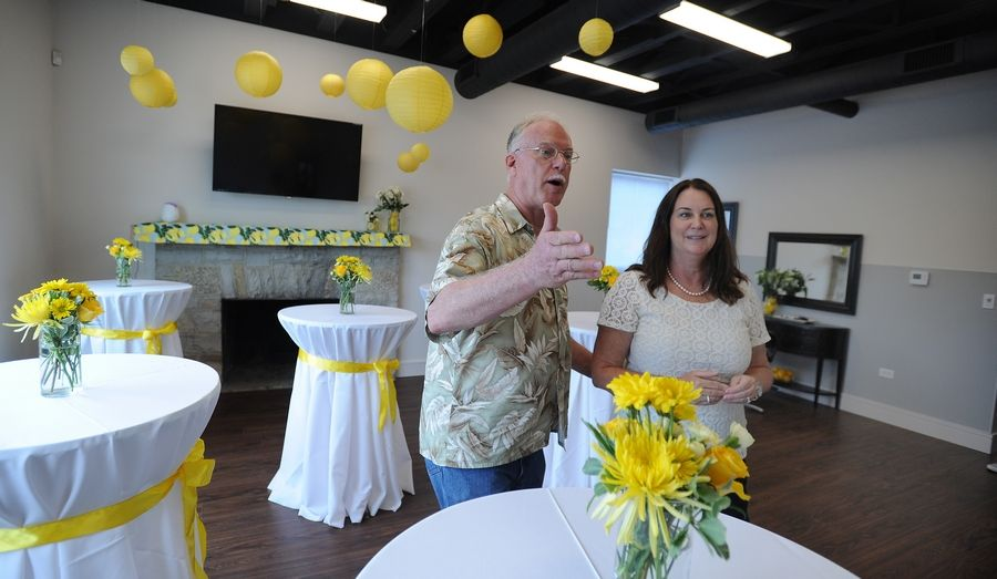 The founder of Lemons of Love and a 2014 cancer survivor, Jill Swanson, shows off her group's new Cancer Resource Center to Steve Polit of Mount Prospect, a 1994 cancer survivor, at the grand opening on Saturday.
