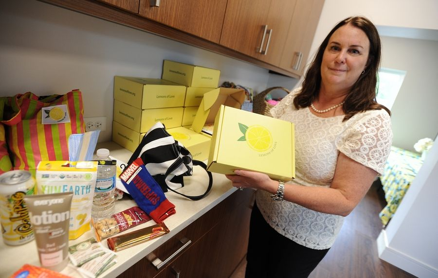 The founder of Lemons of Love and a 2014 cancer survivor, Jill Swanson, shows off chemo care boxes filled with things to make hours of getting chemotherapy more tolerable at her group's new Cancer Resource Center, which will offer services to cancer patients, survivors, and caregivers.