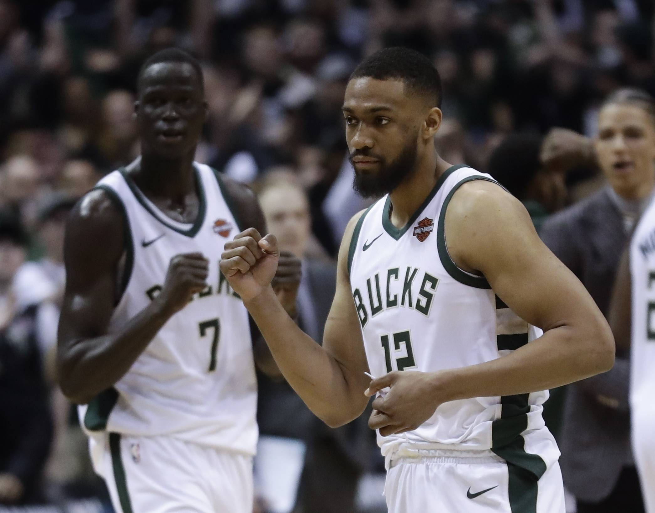 Milwaukee Bucks' Thon Maker (7) and Jabari Parker celebrate after a first-round playoff game last April.