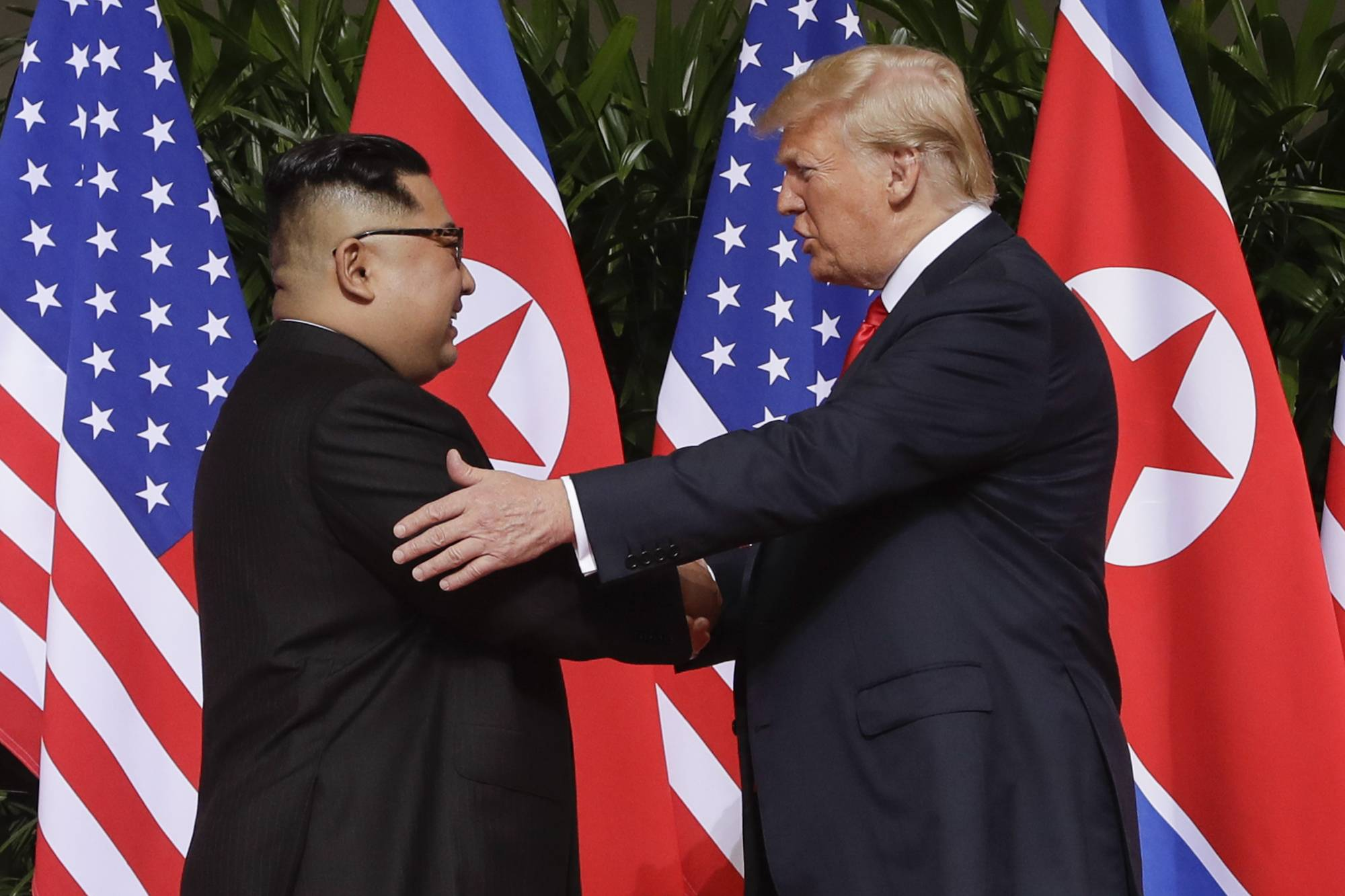 U.S. President Donald Trump shakes hands with North Korea leader Kim Jong Un at the Capella resort on Sentosa Island in Singapore. President Donald Trump has already met with Russian President Vladimir Putin twice, but he is eager to recreate in Finland the heady experience that he had last month with North Korean leader Kim Jong Un. That Singapore summit became a mass media event complete with powerful presidential images.