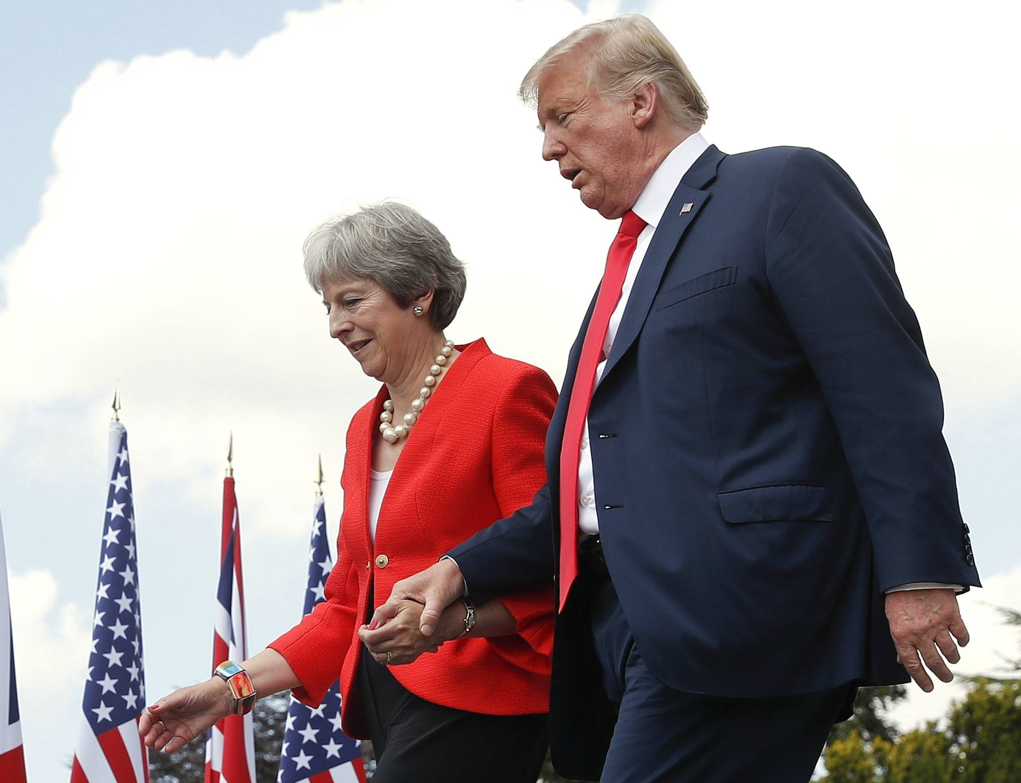 President Donald Trump and British Prime Minister Theresa May hold hands Friday at the conclusion of their joint news conference at Chequers in Buckinghamshire, England.