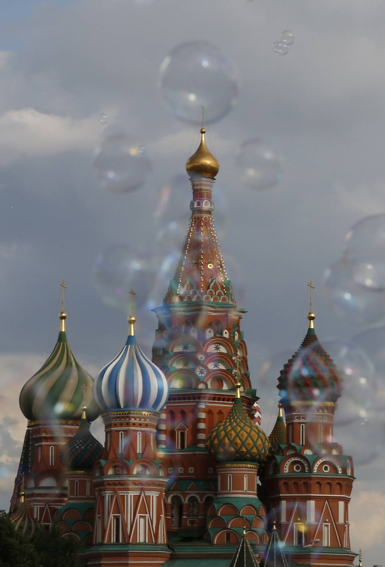 Bubbles float past St. Basil's Cathedral in Red Square Friday during the 2018 soccer World Cup in Moscow.