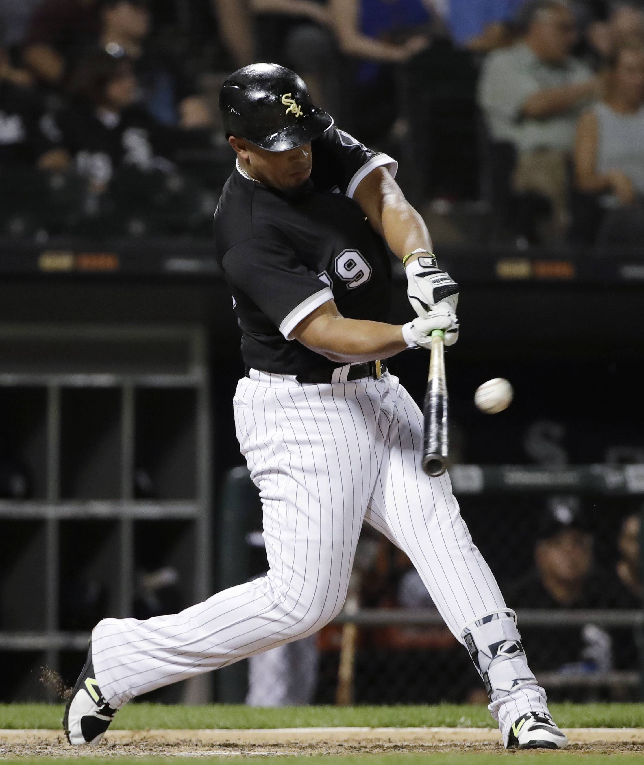 Chicago White Sox's Jose Abreu hits a solo home run against the Kansas City Royals during the sixth inning of a baseball game Friday, July 13, 2018, in Chicago. (AP Photo/Nam Y. Huh)