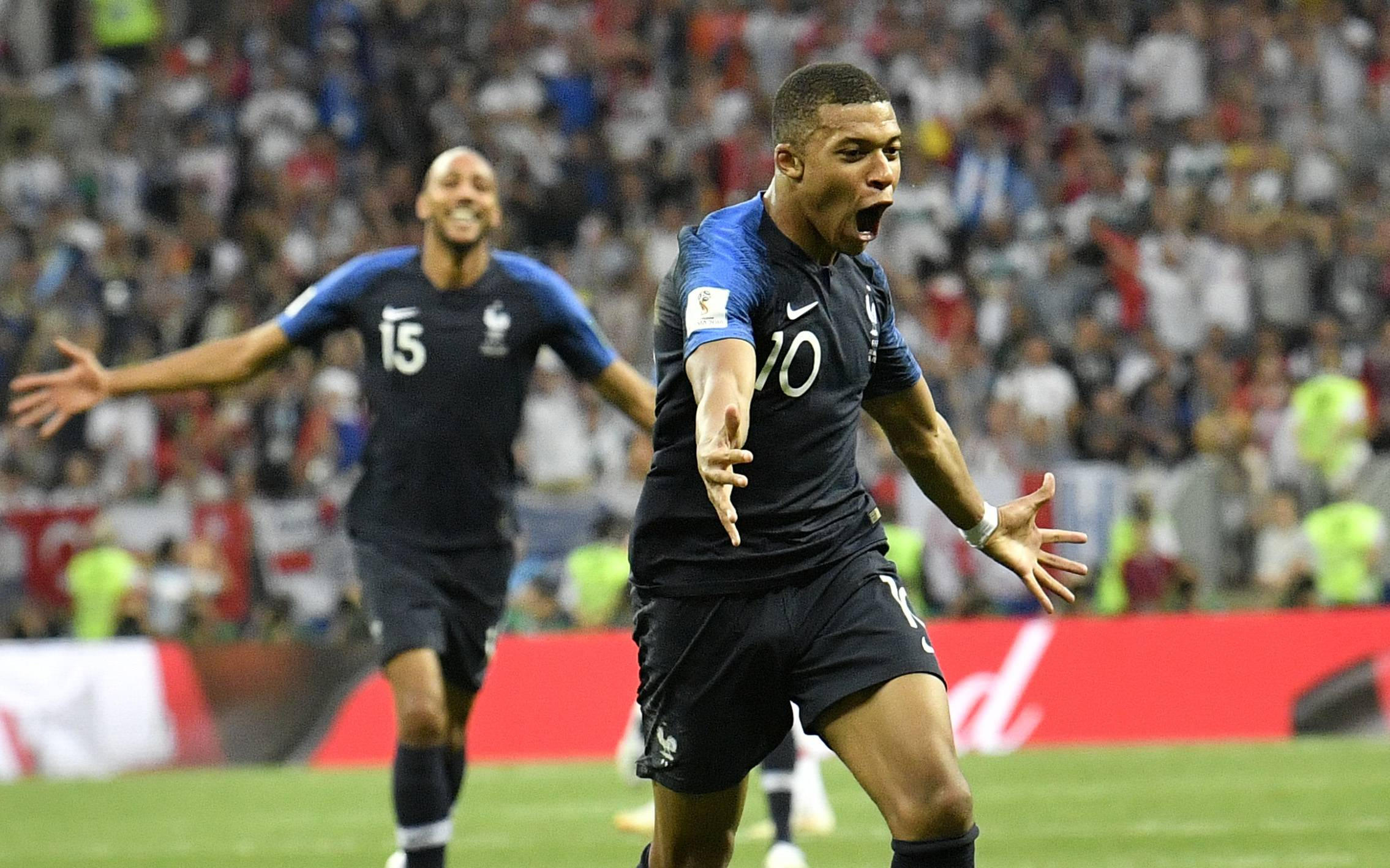France's Kylian Mbappe, front, celebrates after scoring his side's fourth goal during the final match between France and Croatia at the 2018 soccer World Cup in the Luzhniki Stadium in Moscow, Russia, Sunday, July 15, 2018. (AP Photo/Martin Meissner)