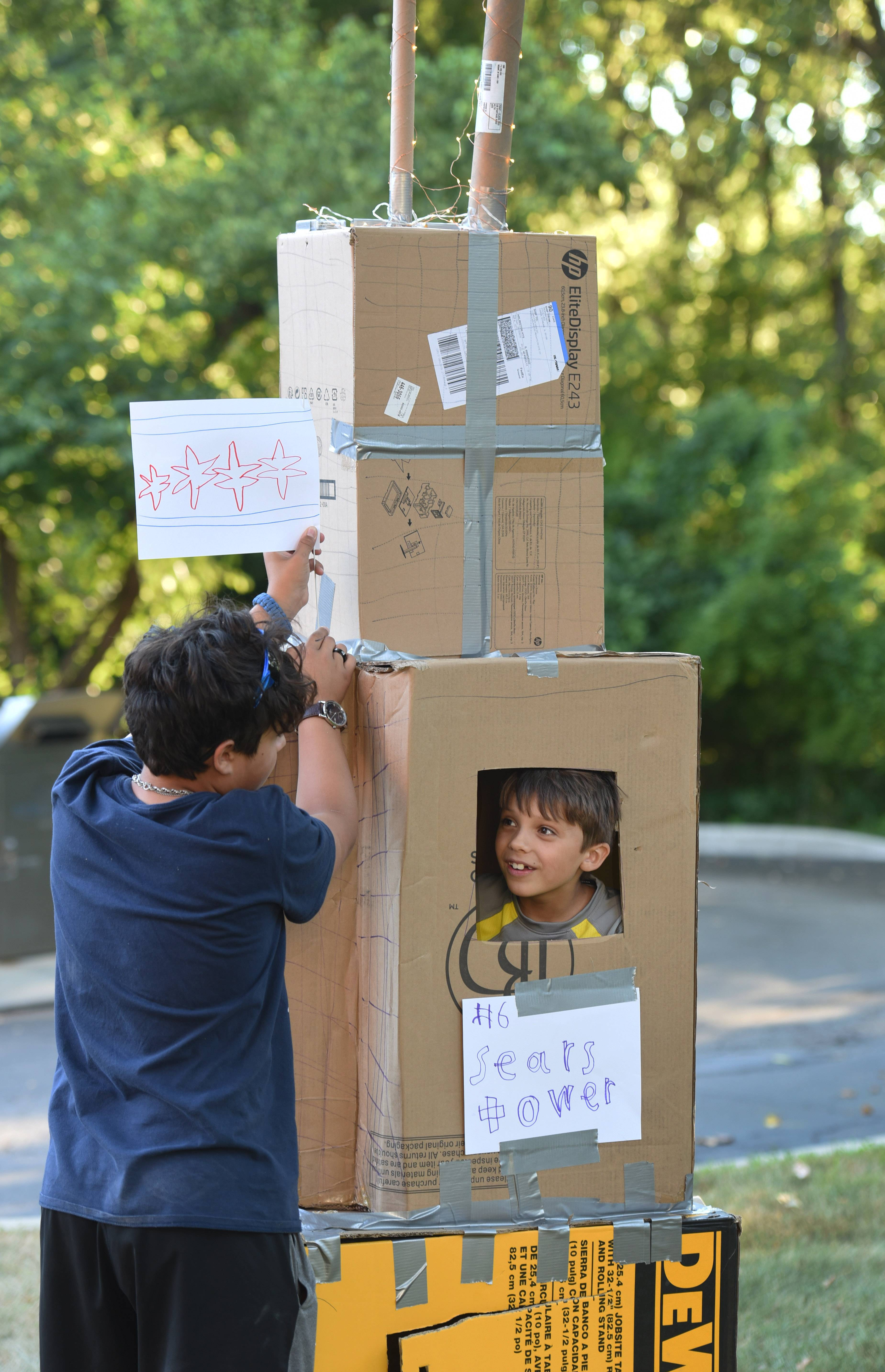Gabriel Kruzich, left, and his brother Ethaniel Kruzich, both from Montana, are visiting family in Wauconda and participated in Monday night's Second Annual Family Fort Build at the Wauconda Area Library. The group built the Sears Tower as their official entry.
