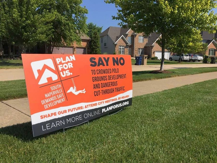 Some residents of South Pointe and other subdivisions near the proposed Polo Club development in south Naperville have posted yard signs against it.
