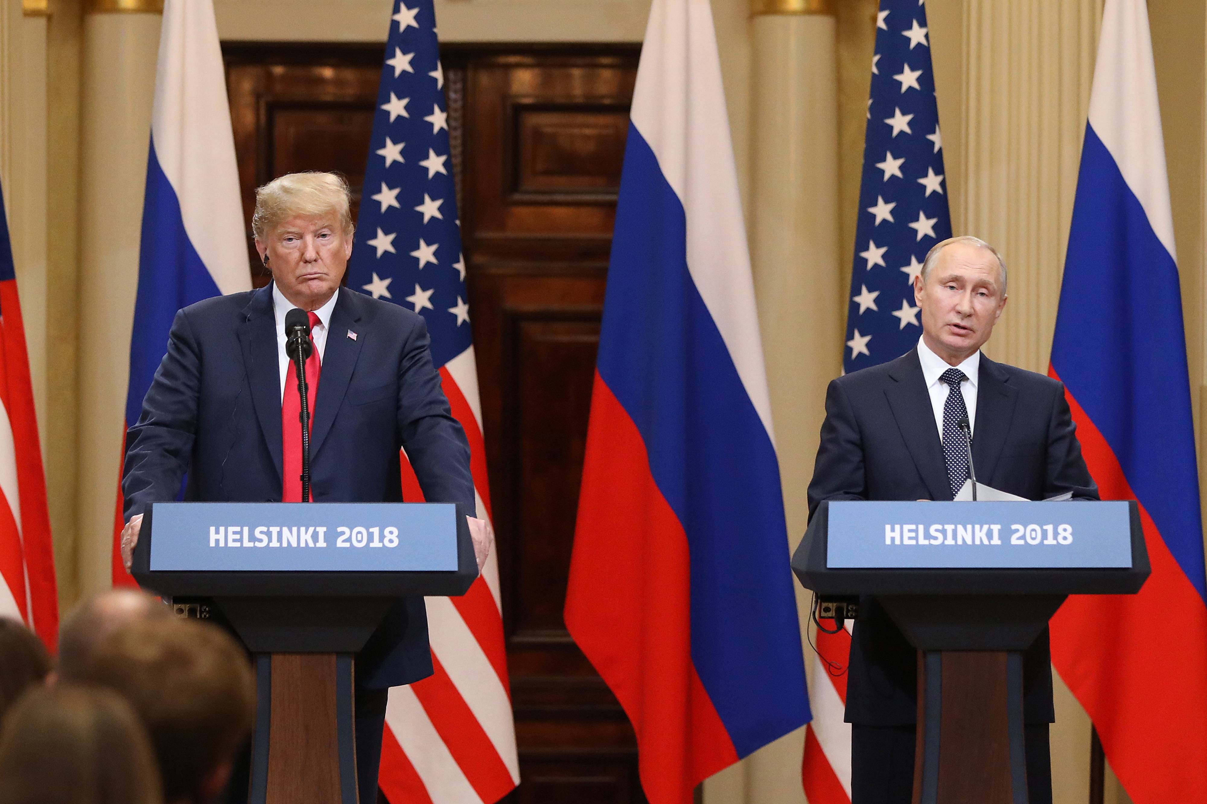President Donald Trump, left, listens as Vladimir Putin, Russia's president, speaks during a news conference in Helsinki, Finland, on July 16, 2018. MUST CREDIT: Bloomberg photo by Chris Ratcliffe