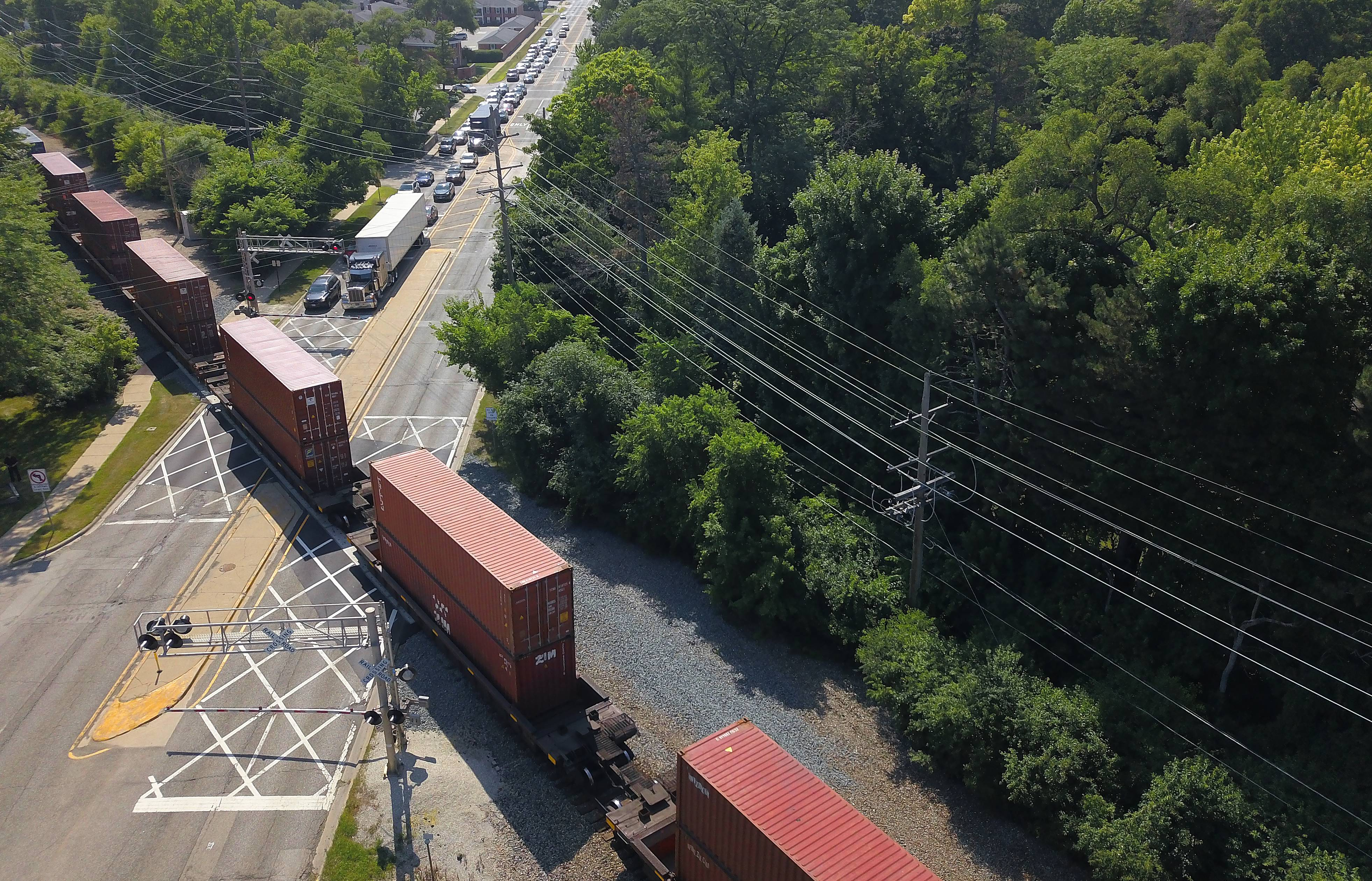 A CN freight train slowly makes its way through Barrington at Northwest Highway.