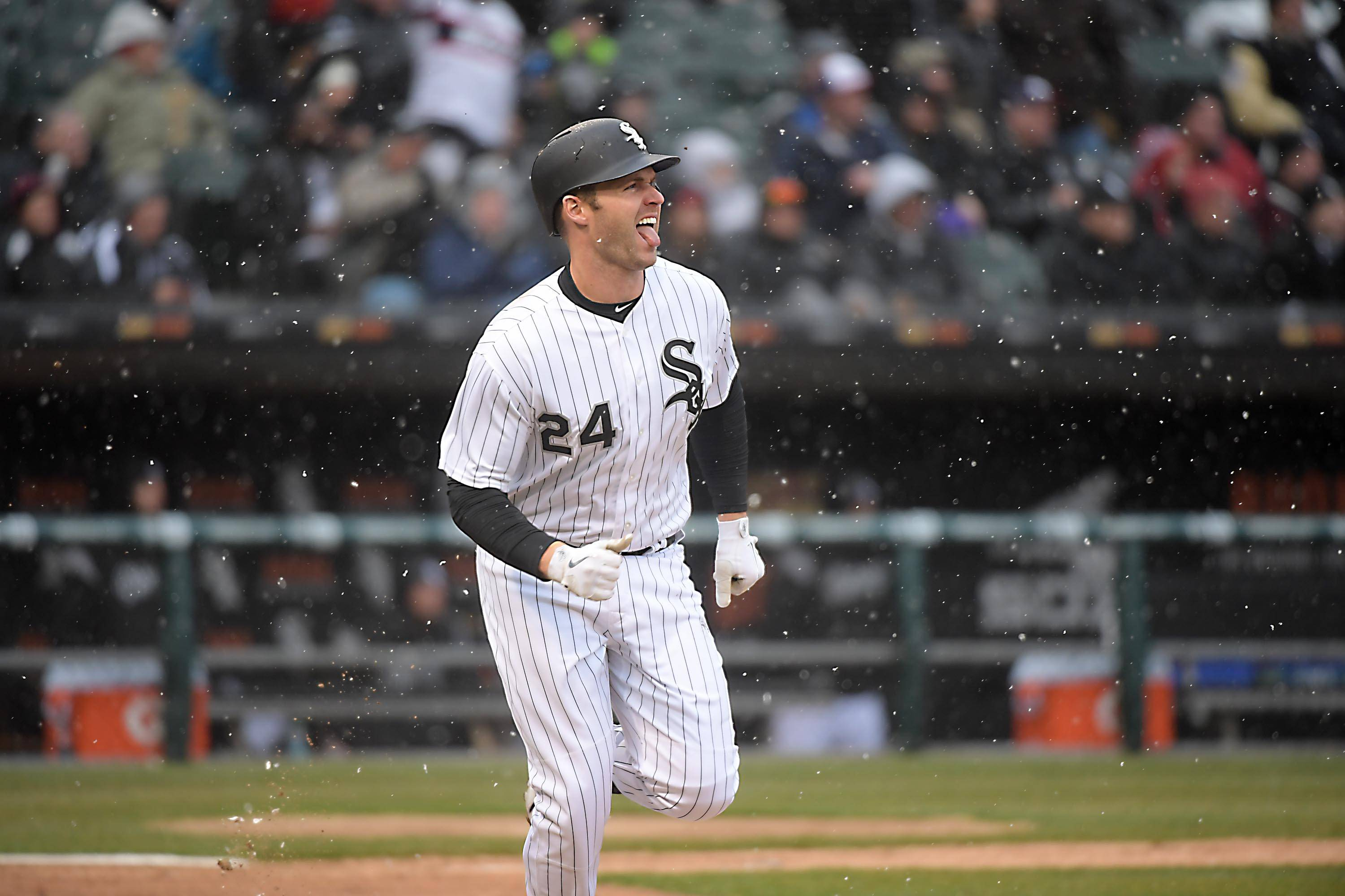 Chicago White Sox batter Matt Davidson sticks out his tongue as he watches his one-run double in the fifth inning in the home opener game against the Detroit Tigers Thursday at Guaranteed Rate Field in Chicago.