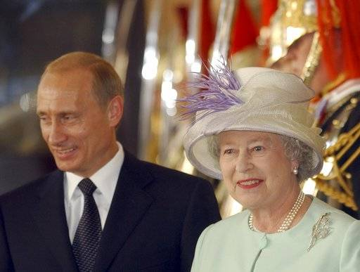 FILE - In this June 24, 2003 file photo Russian President, Vladimir Putin, stands by Britain's Queen Elizabeth II before they enter Buckingham Palace, London.