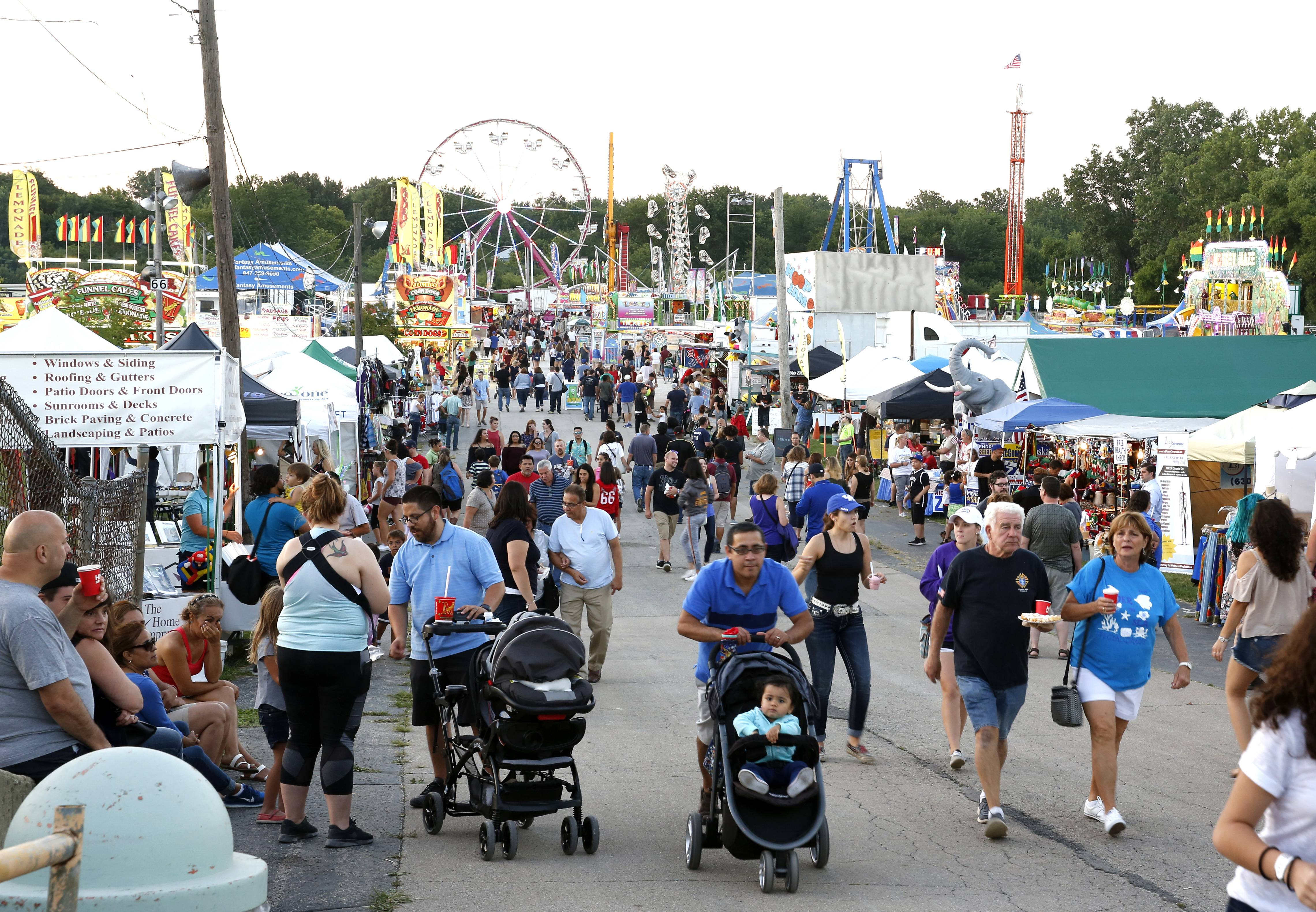 Rides, vendors and exhibits line the midway at last year's DuPage County Fair. Four local counties — DuPage, Kane, Lake and McHenry — have county fairs starting in July.