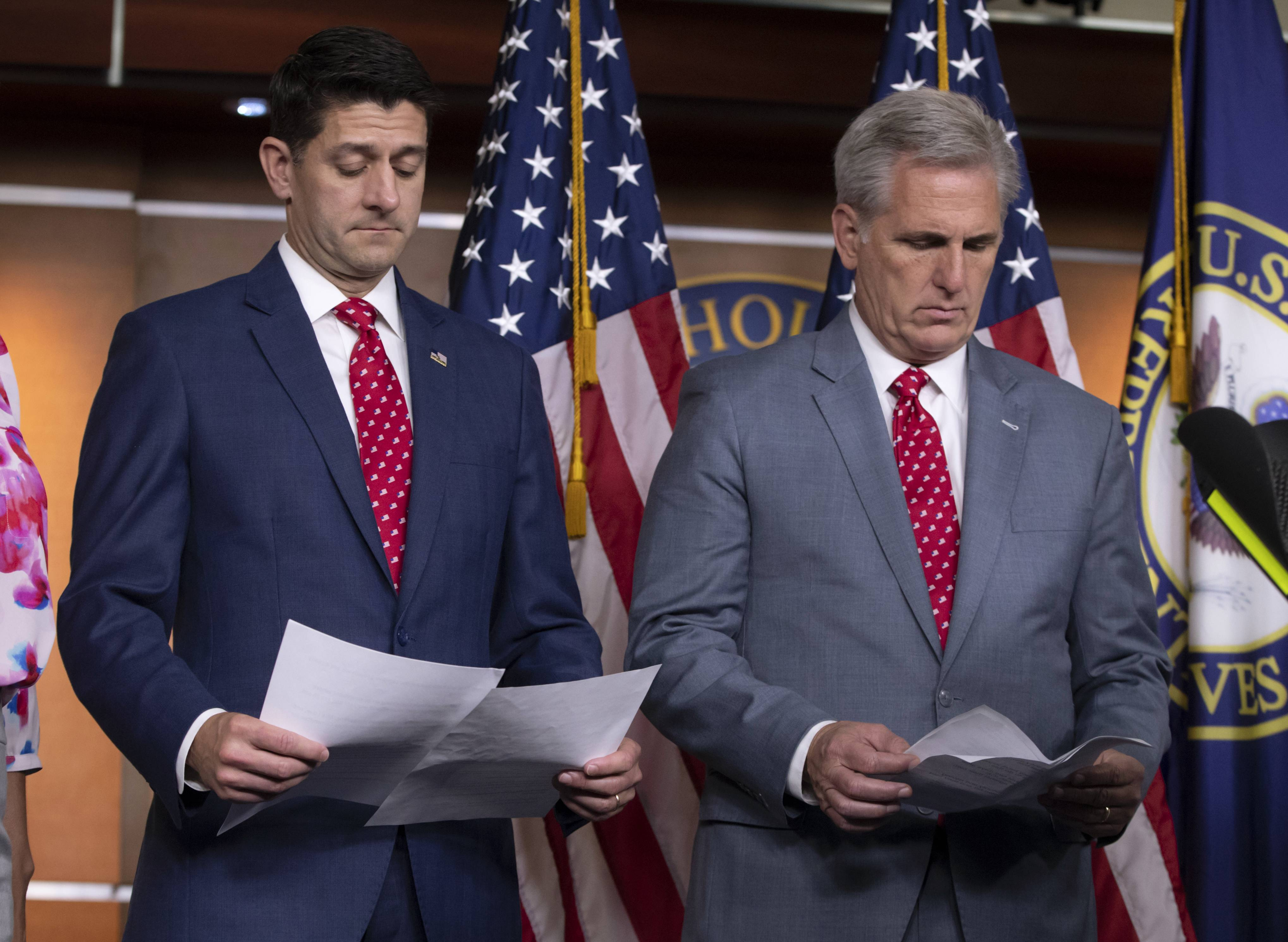 Speaker of the House Paul Ryan, R-Wis., left, and Majority Leader Kevin McCarthy, R-Calif., review papers Tuesday before answering questions from reporters on Capitol Hill in Washington. Responding to criticism about President Donald Trump and his Helsinki news conference with Russian President Vladimir Putin, Ryan said there should be no doubt that Russia interfered in the 2016 presidential election.