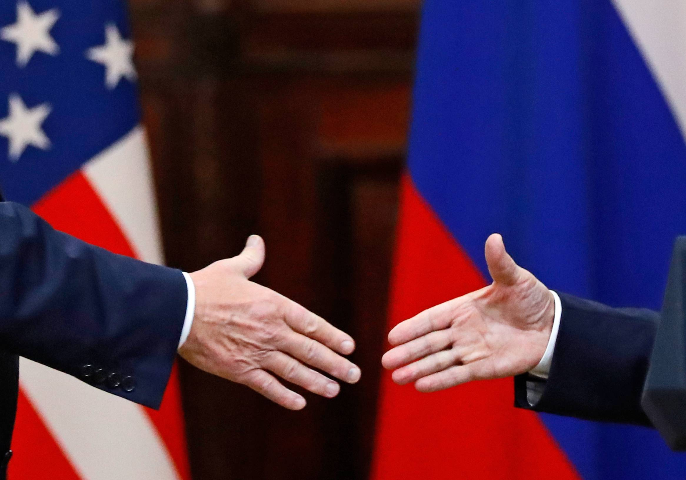 U.S. President Donald Trump shakes hands Monday with Russian President Vladimir Putin at the end of the news conference after their meeting at the Presidential Palace in Helsinki, Finland.