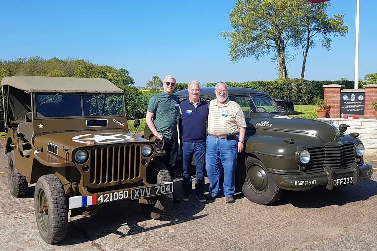 Alex, Tim and Bob Wayman prepare for a Jeep ride at the 95th Bomb Group site and museum in Horham, England, where Chuck Wayman was stationed for three months before being shot down in 1944. Members of the Wayman family were on a tour hosted by the National World War II Museum in New Orleans.