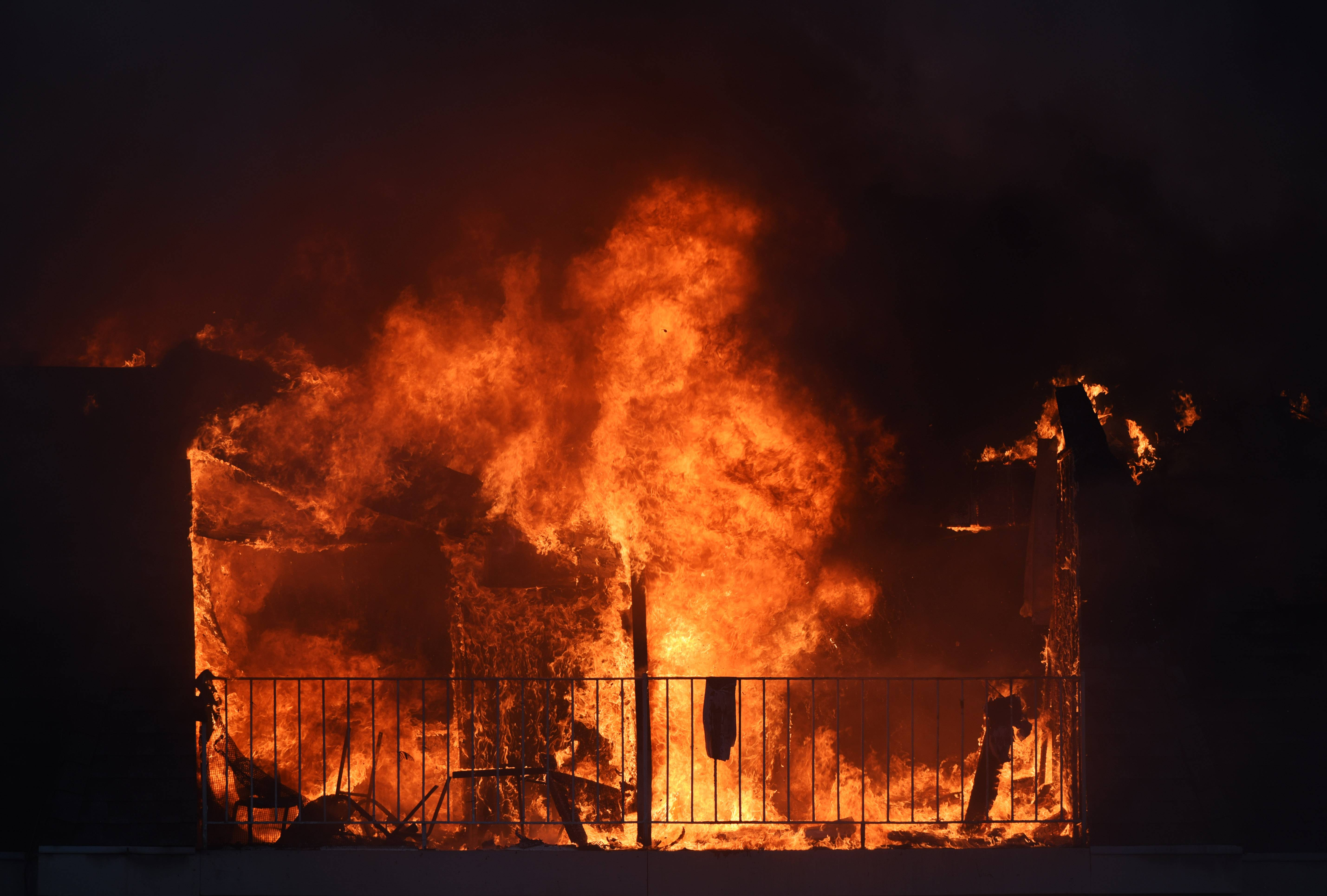 An apartment unit is engulfed in flames as firefighters work to extinguish a blaze at an apartment complex located in the 800 block of McIntosh Ct. in Prospect Heights Wednesday.
