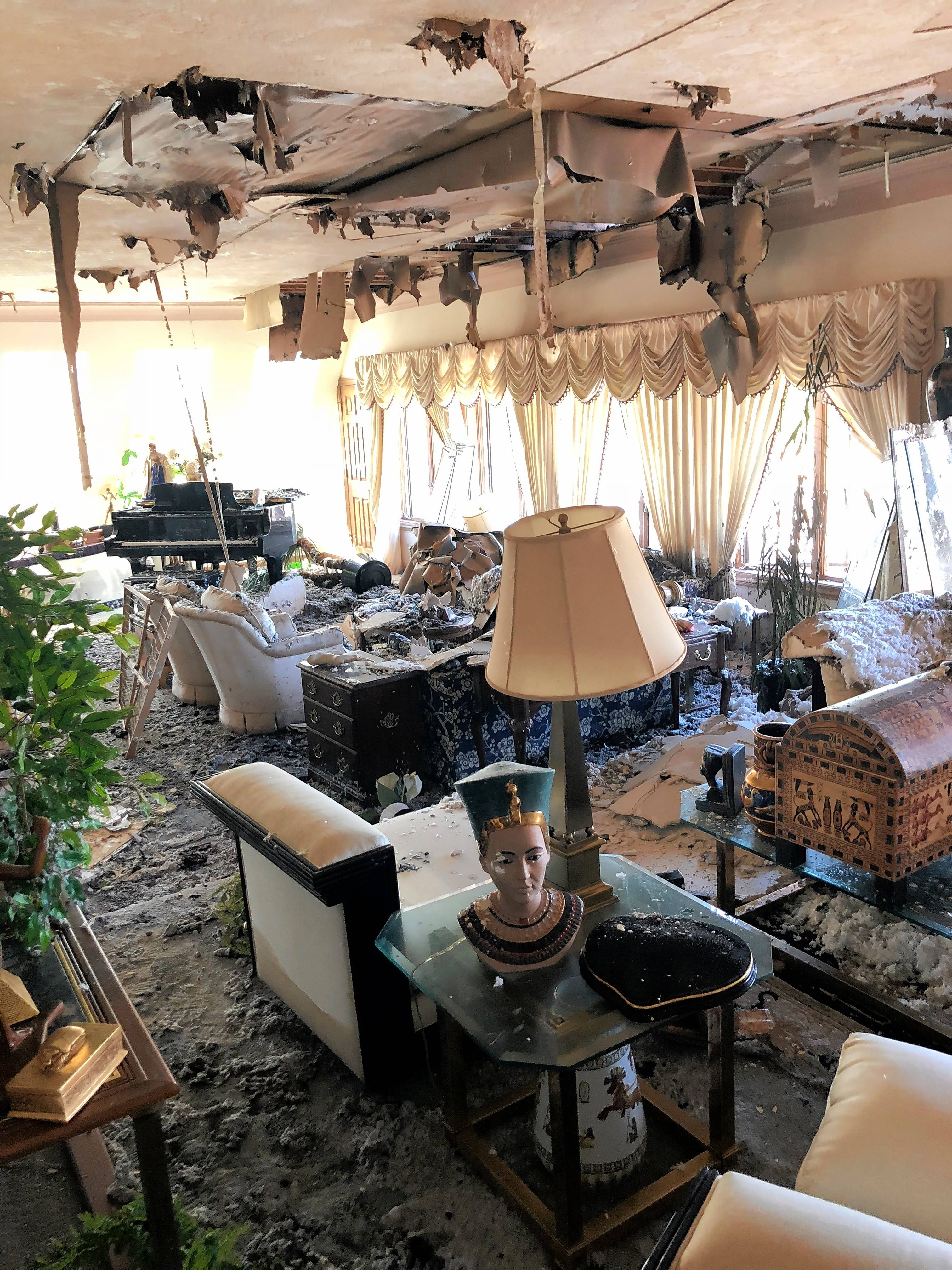 One of the damaged rooms inside the Gold Pyramid House in Wadsworth, where the owners have yet to assess all the damage from water and collapsed ceilings and walls.