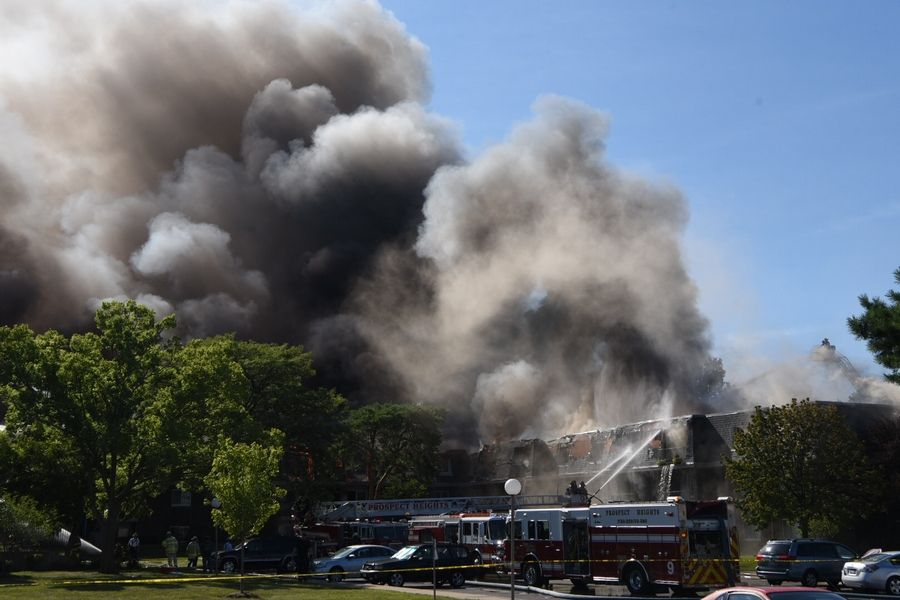 Firefighters spent hours battling a massive fire Wednesday at the River Trails condominium complex in Prospect Heights. Residents of 96 apartments were evacuated because of the fire.