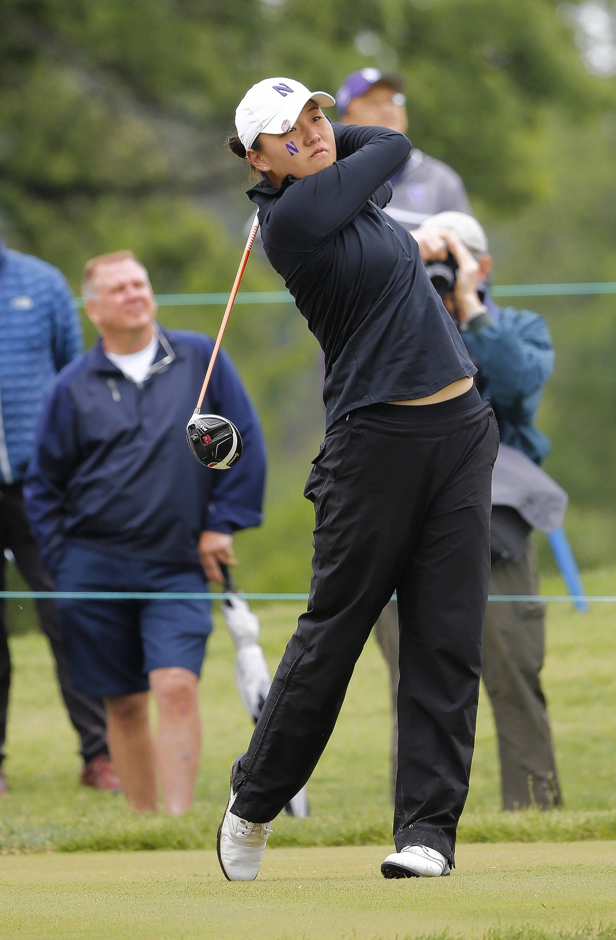 Hannah Kim, here teeing off for Northwestern during the final round of the NCAA Division I Women's Golf Championships against Arizona State at Rich Harvest Farms on May 24, 2017, picked up her first professional victory Wednesday. (AP Photo/Charles Rex Arbogast)