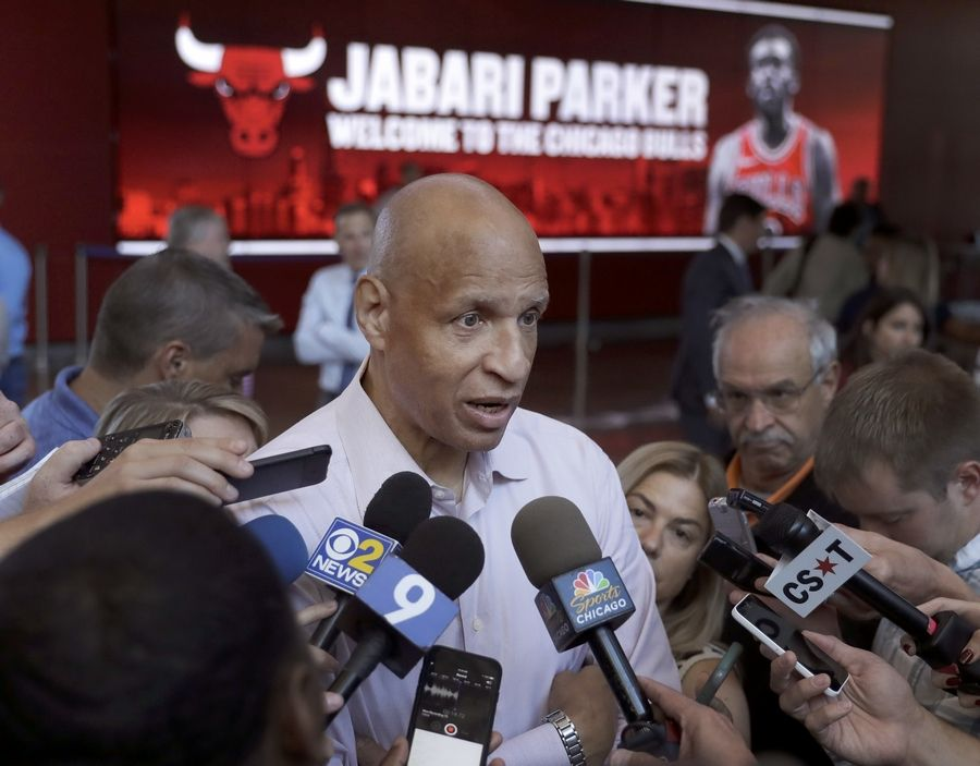 Jabari Parker's father Sonny, a retired NBA player with the Golden State Warriors, talks with reporters after a news conference where his son was introduced as the newest member of the Bulls Wednesday, July 18, 2018, in his hometown of Chicago.