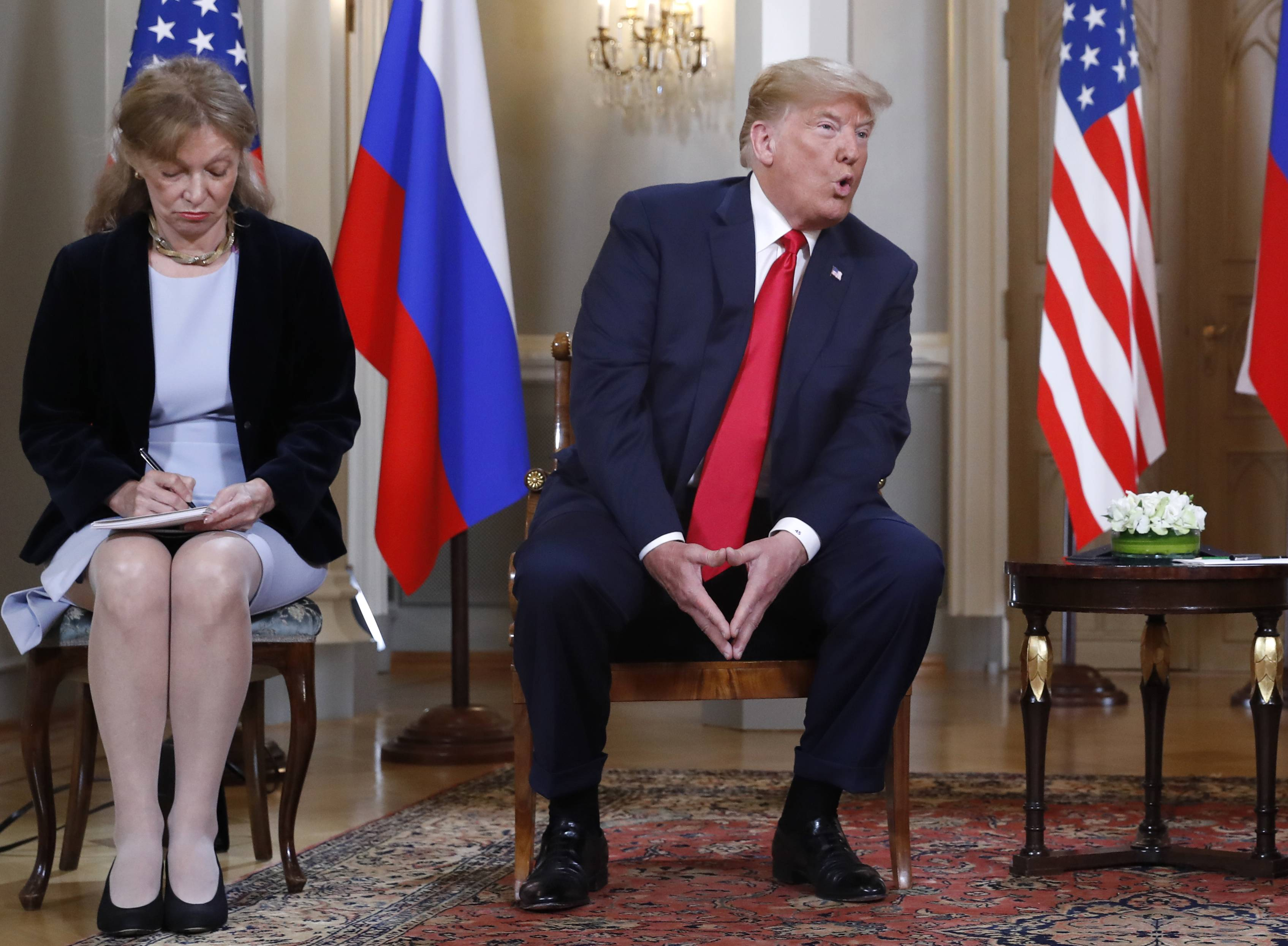 Interpreter Marina Gross, left, takes notes Monday when U.S. President Donald Trump talks to Russian President Vladimir Putin at the beginning of their one-on-one-meeting at the Presidential Palace in Helsinki, Finland.