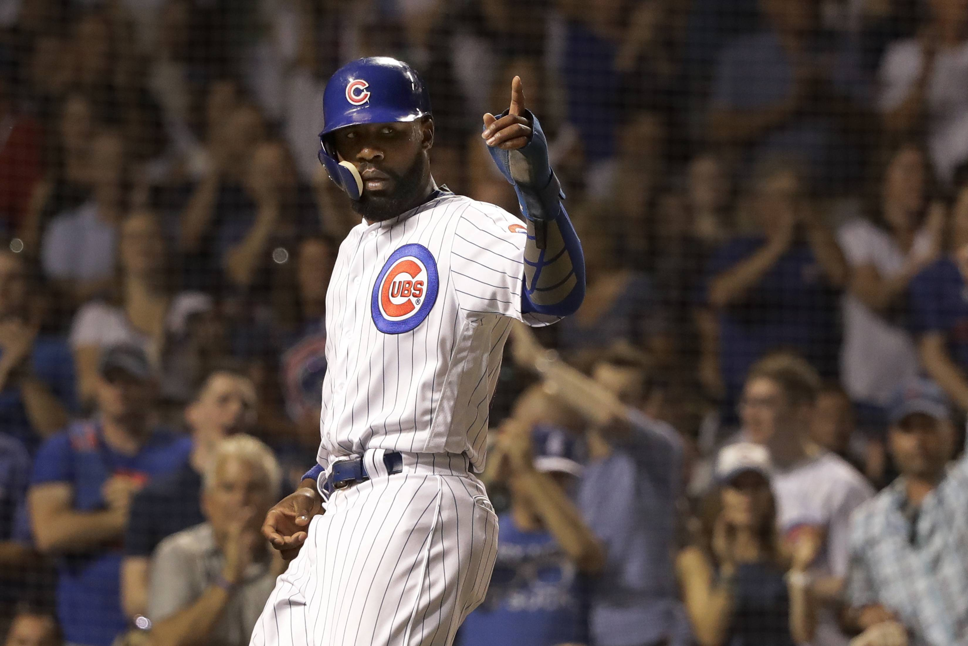 Chicago Cubs' Jason Heyward points to Ben Zobrist on first after he scored on Zobrist's single during the seventh inning of a baseball game against the St. Louis Cardinals, Thursday, July 19, 2018, in Chicago. The Cubs won 9-6. (AP Photo/Charles Rex Arbogast)
