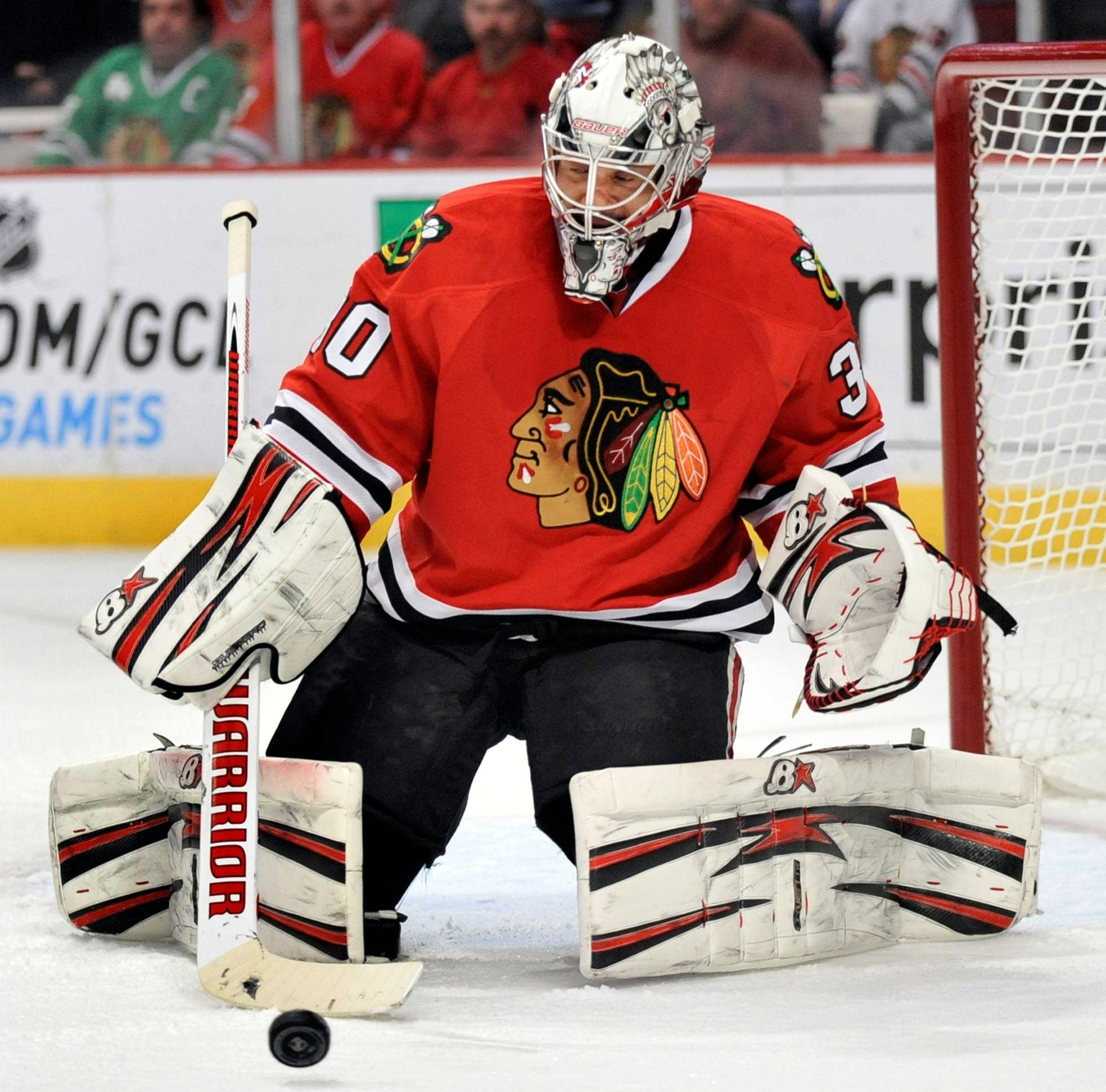 Chicago Blackhawks goalie Ray Emery makes a save against the Anaheim Ducks during the first period of an NHL hockey game in Chicago, Friday, March, 29, 2013. (AP Photo/Paul Beaty)