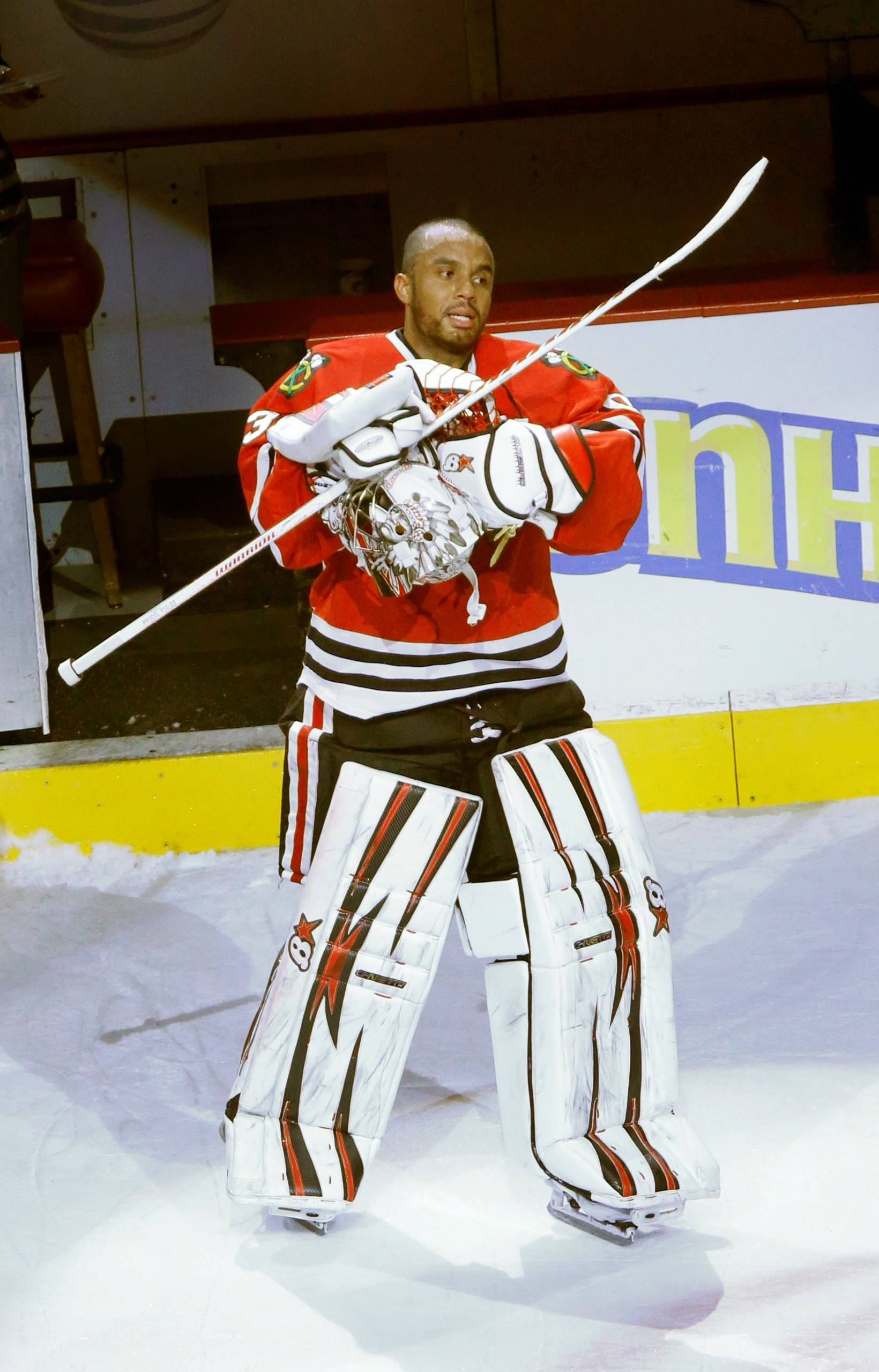 Chicago Blackhawks goalie Ray Emery salutes the fans after being named a star of the Blackhawks' 2-0 win over the Calgary Flames after an NHL hockey game Tuesday, March 26, 2013 in Chicago.