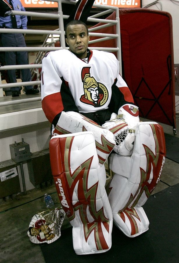 FILE - In this Dec. 12, 2007 file photo Ottawa Senators goalie Ray Emery watches during the third period of an NHL hockey game against the Carolina Hurricanes in Raleigh, N.C.  Emery has drowned in his hometown of Hamilton, Ontario. He was 35. Hamilton Police confirmed Emery was identified as the victim of the swimming accident Sunday, July 15, 2018.