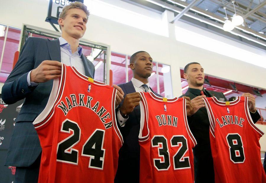 "It remains to be seen how the Bulls will use players like, from left, Lauri Markkanen, Kris Dunn and Zach LaVine next year. Those three and new addition Jabari Parker probably won't have ""the exact roles on the first day as ... the middle or end of the season,"" coach Fred Hoiberg said, and finding out how each player will fit in the Bulls system will ""be a big part of what we're looking for heading into training camp."""