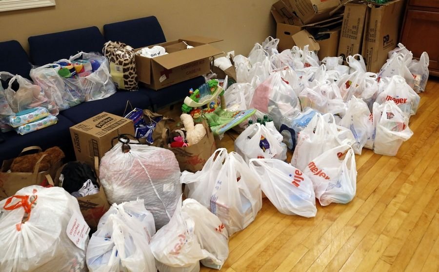 Donations of clothing, toiletries and other items were piling up Thursday at Lakewood Chapel in Arlington Heights. The church and American Red Cross are working together to offer shelter, food, clothing and showers to residents displaced by Wednesday's apartment fire in Prospect Heights.