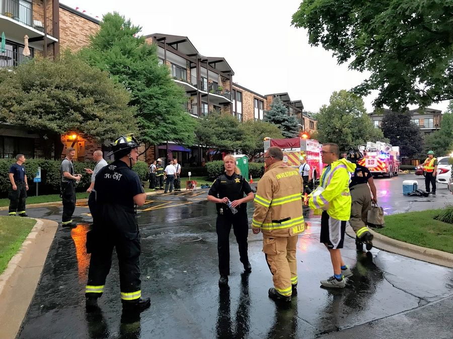Firefighters assisted residents after a fire Friday at an apartment complex on Yarmouth Place in Mount Prospect.