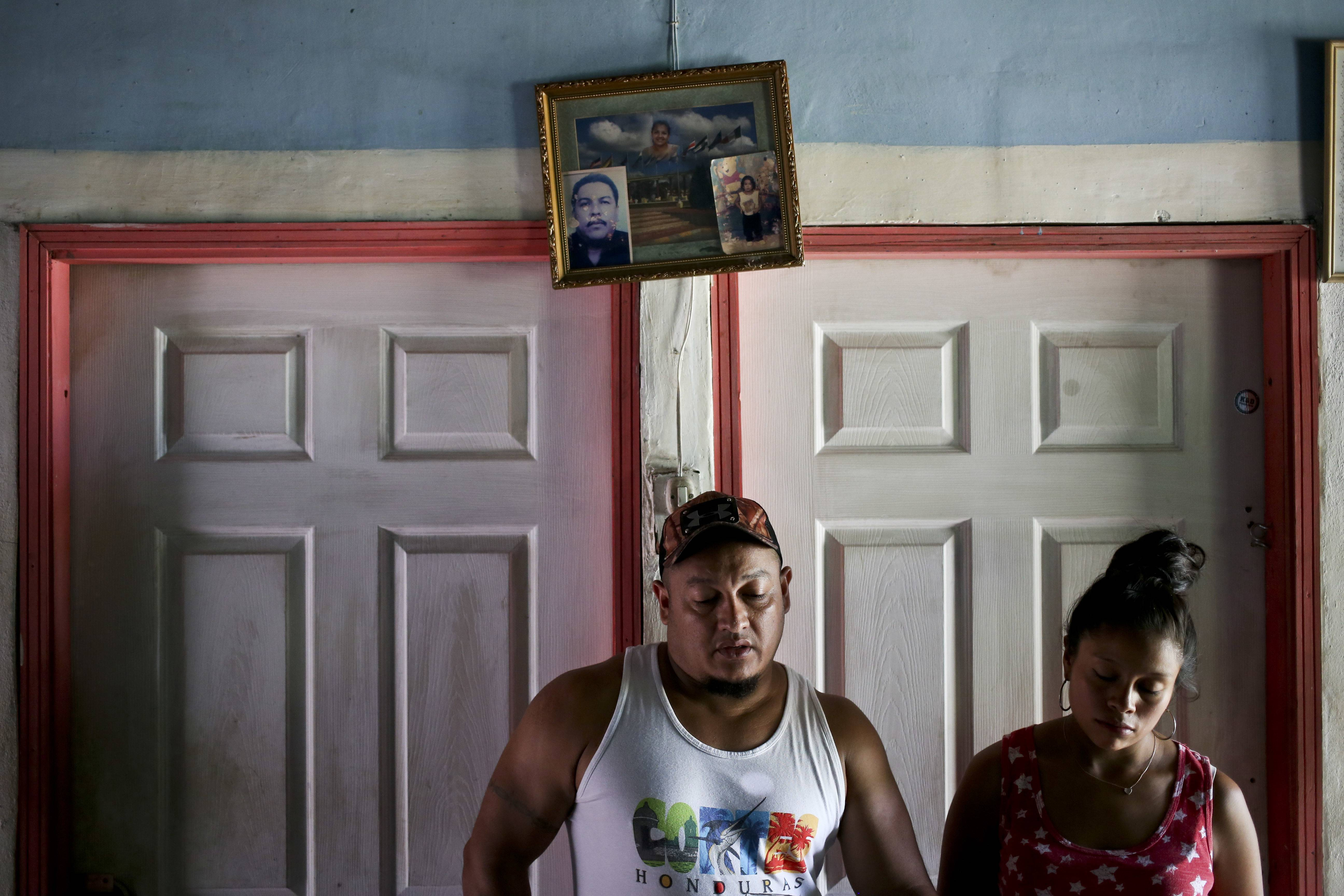 In this July 18, 2018 photo, Rolando Bueso Castillo and his wife Adalicia Montecinos, stand in their home in La Libertad, Honduras. It's been five months since they have seen their infant son Johan Bueso Castillo who was separated from Bueso Castillo at the Texas border in March and sent to a shelter in Arizona. (AP Photo/Esteban Felix)
