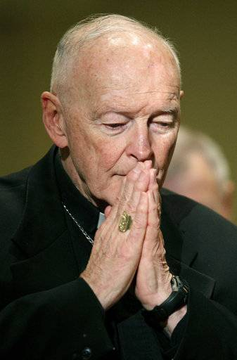 FILE - In this Nov. 14, 2011 file photo, Cardinal Theodore McCarrick prays during the United States Conference of Catholic Bishops' annual fall assembly in Baltimore. Allegations that the most respected U.S. cardinal repeatedly sexually abused both boys and adult seminarians has raised questions about who in the Catholic Church hierarchy knew, and what Pope Francis is going to do about it. If the accusations against Cardinal Theodore McCarrick bear out, will Francis revoke his title of cardinal, sanction him to a lifetime of prayer or even defrock him, the expected sanction if McCarrick were a mere priest?