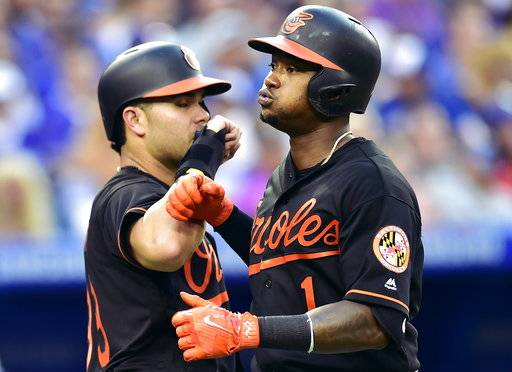 Baltimore Orioles' Tim Beckham (1) is congratulated by teammate Renato Nunez, left, for his two-run home run during fifth-inning baseball game action against the Toronto Blue Jays in Toronto, Friday, July 20, 2018. (Frank Gunn/The Canadian Press via AP)