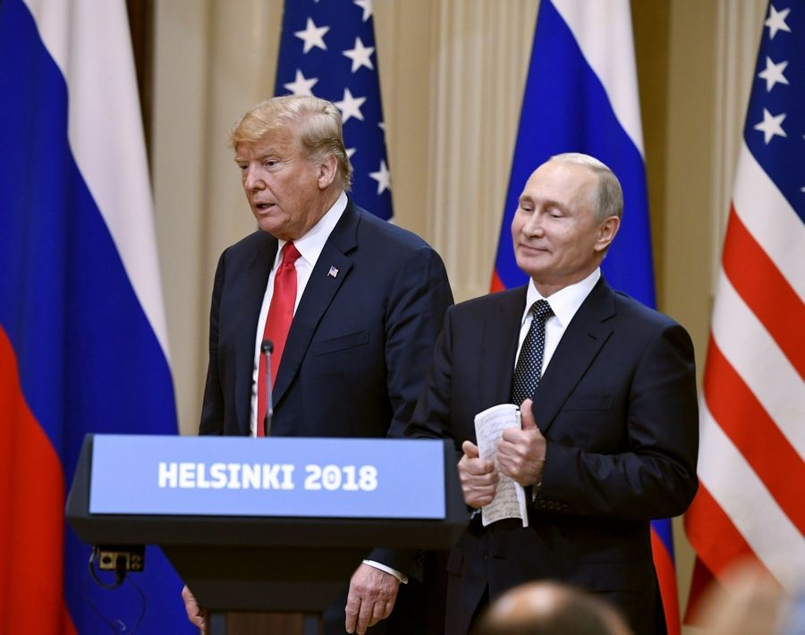 President Donald Trump and Russian President Vladimir Putin arrive Monday for a joint news conference at the Presidential Palace in Helsinki, Finland.