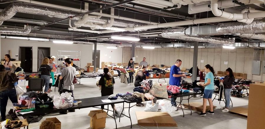 Volunteers at The Bridge Community Church in Prospect Heights sort donated clothing Saturday morning for families displaced by the River Trails condominium complex fire.