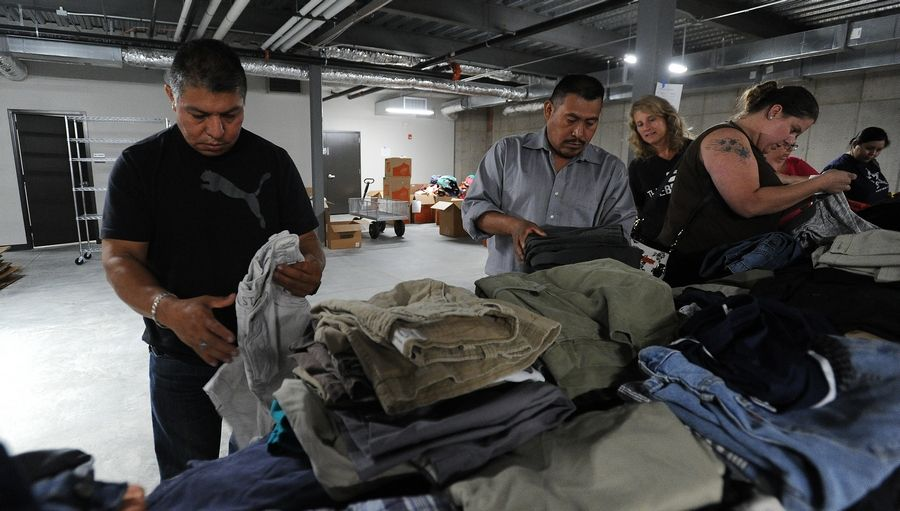 Juan Jovan of Prospect Heights sorts through donated clothes at The Bridge Community Church in Prospect Heights. Juan lost everything except for his identification papers and wallet in Wednesday's apartment complex fire in Prospect Heights.
