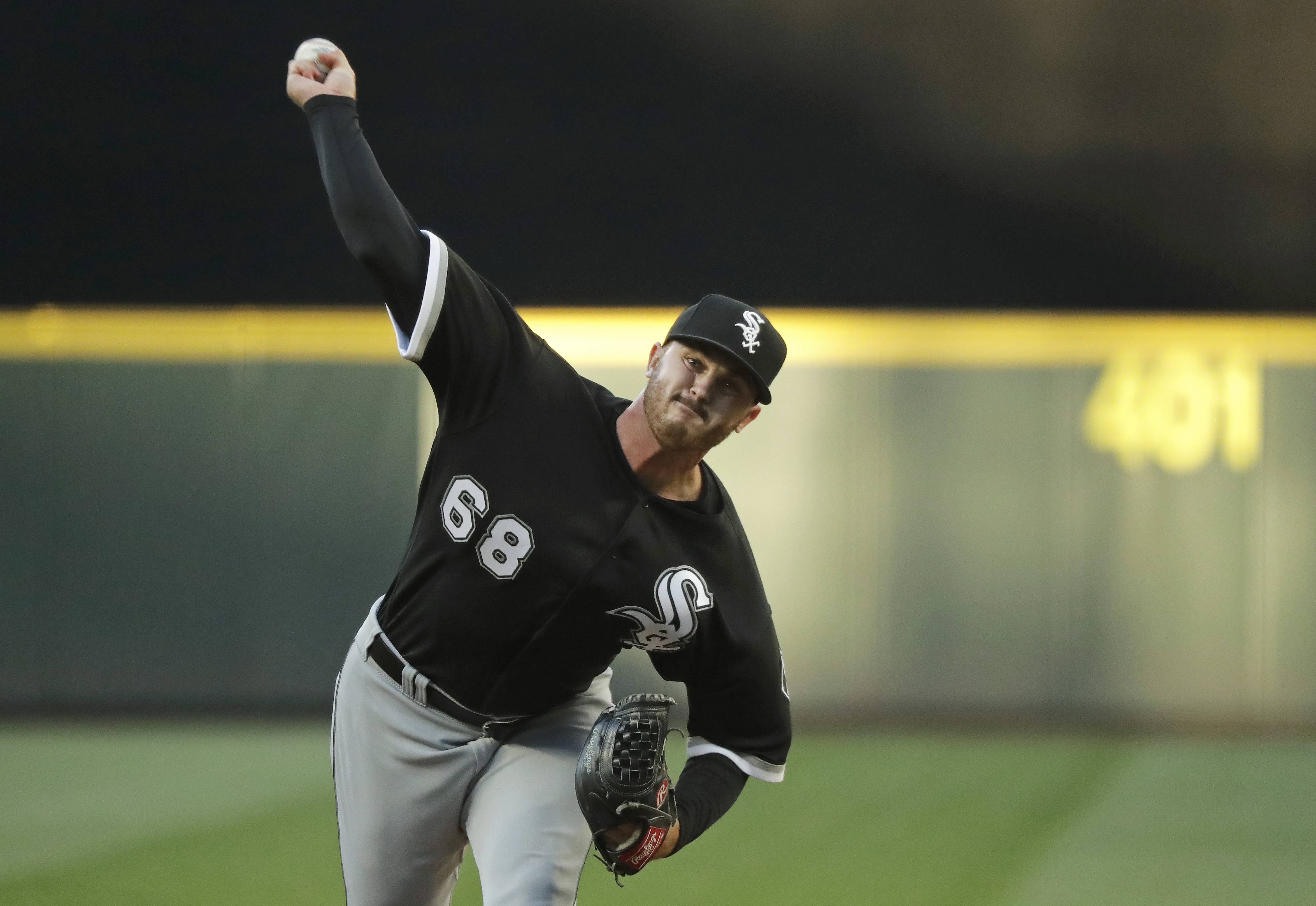 Chicago White Sox starting pitcher Dylan Covey throws against the Seattle Mariners during the third inning of a baseball game, Saturday, July 21, 2018, in Seattle.