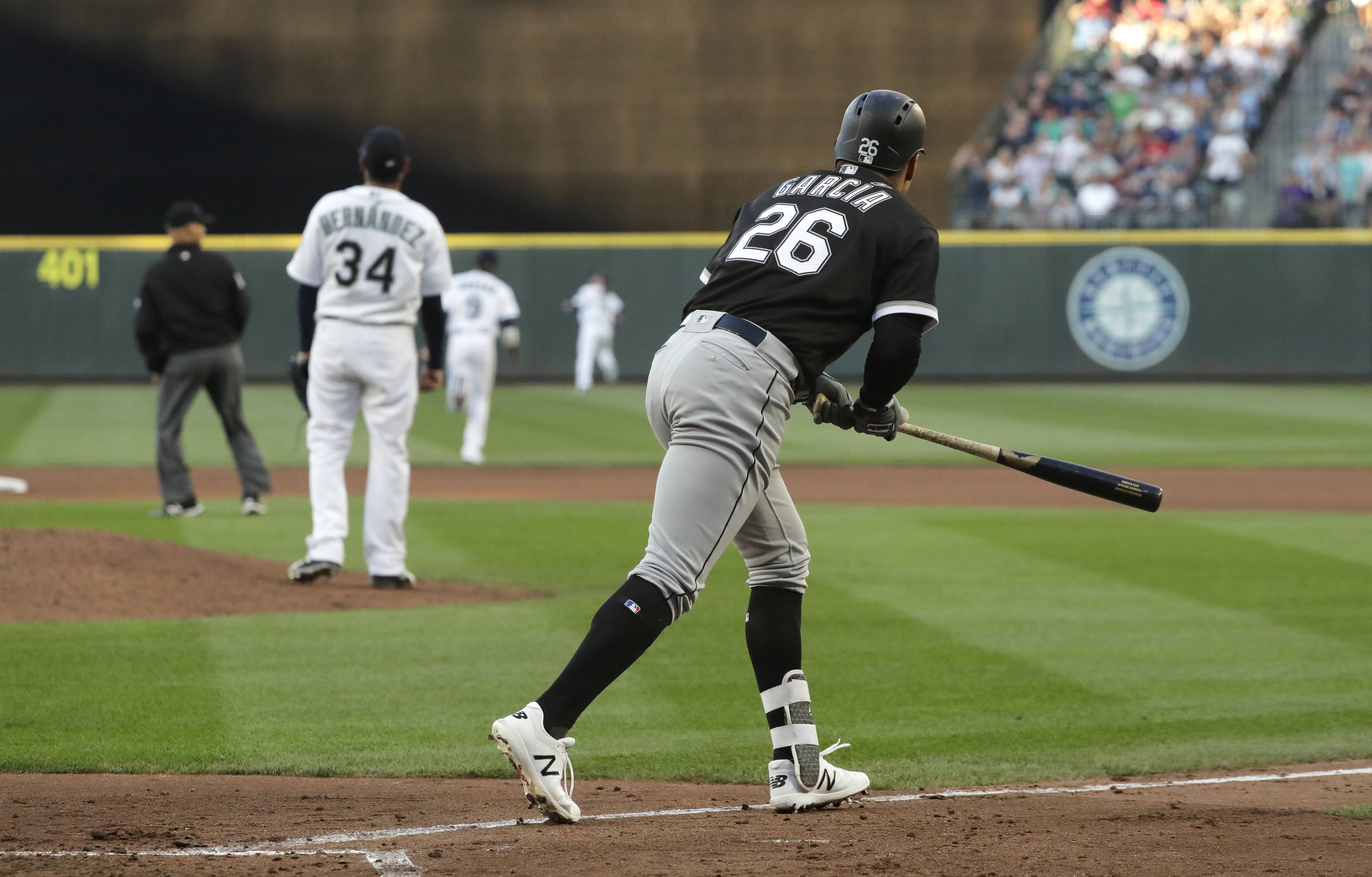 Chicago White Sox's Avisail Garcia (26) watches his three-run home run off Seattle Mariners starting pitcher Felix Hernandez (34) during the fourth inning of a baseball game Saturday, July 21, 2018, in Seattle. (AP Photo/Ted S. Warren)