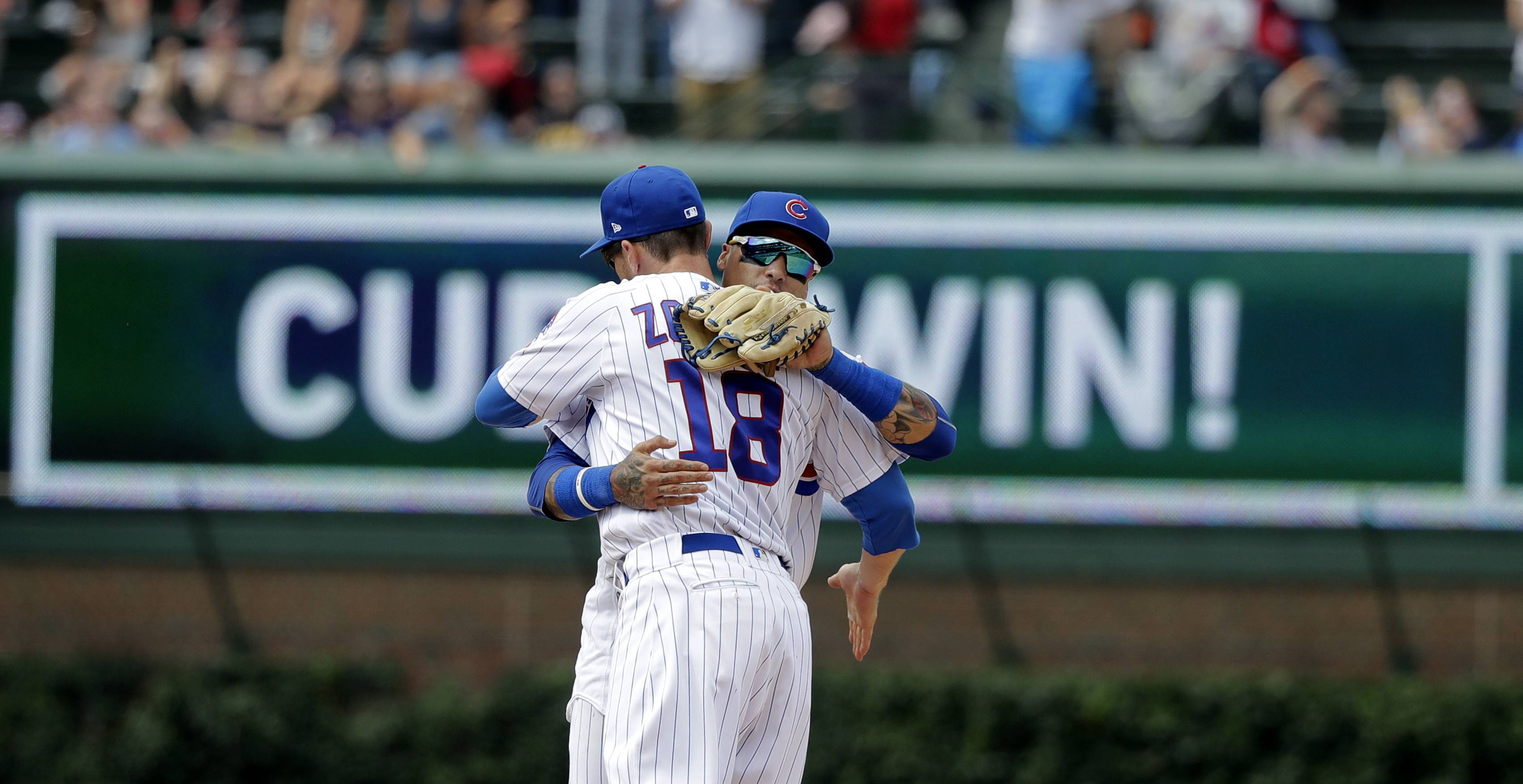 Chicago Cubs' Ben Zobrist (18) and Javier Baez celebrate their win over the St. Louis Cardinals after a baseball game Saturday, July 21, 2018, in Chicago.